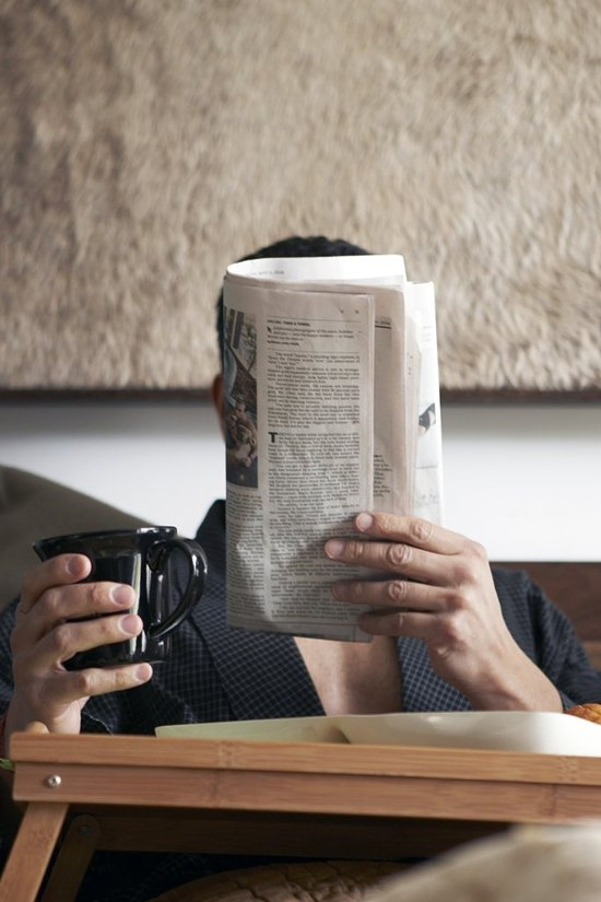 Reading the paper in the morning with coffee ITCHBAN.com