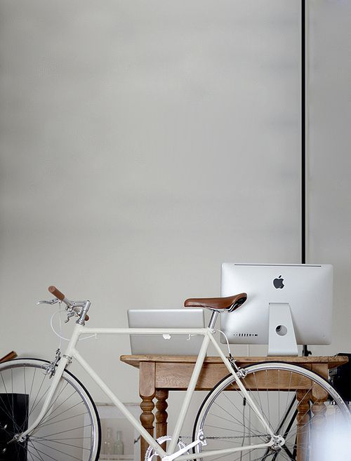 Bicycle leaned on iMac work station ITCHBAN.com