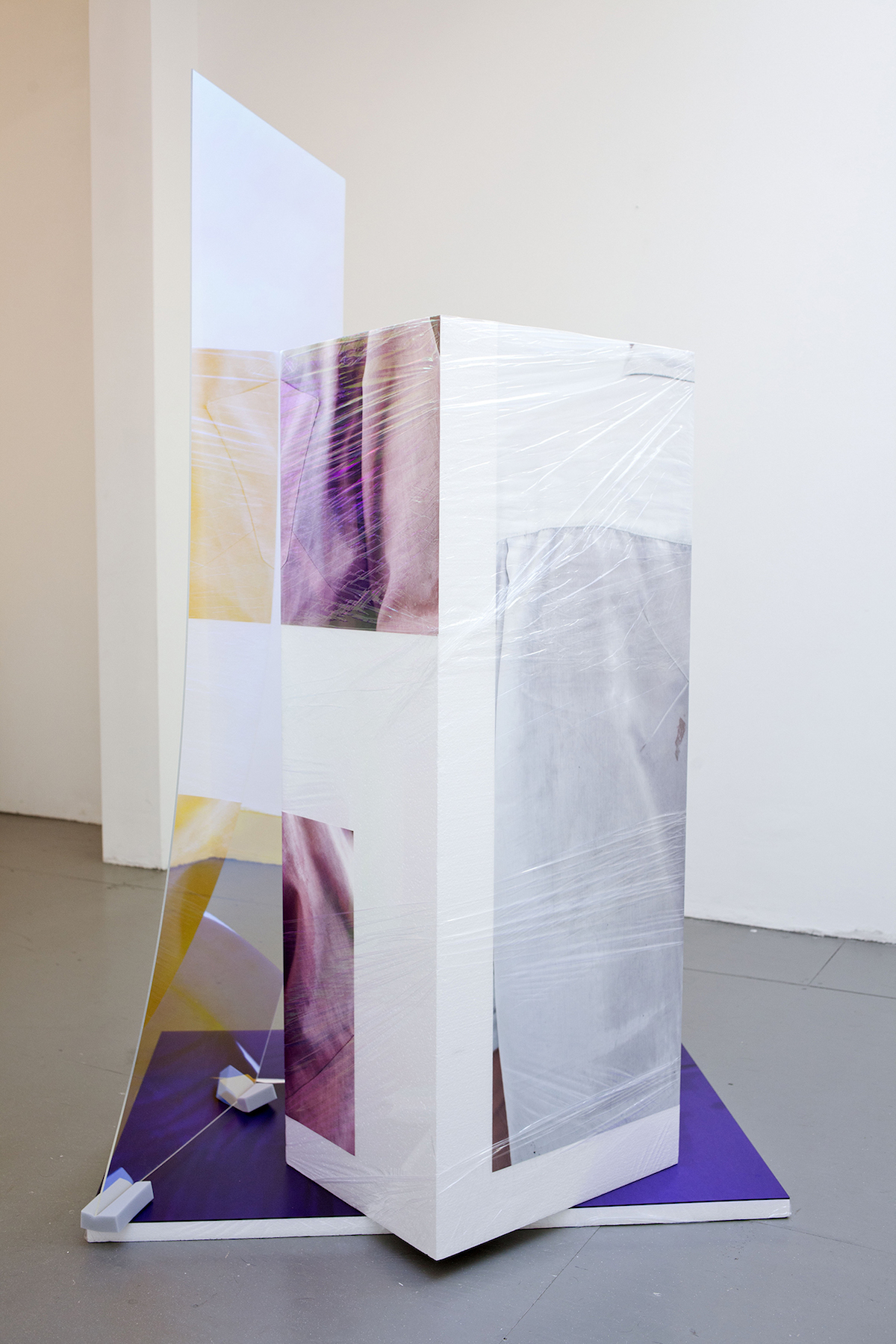 Sweaty Sculpture (back) ,167 x 90 x 107 cm, photo-stickers on polystyrene, cellophane, sponges, radiant plexiglass