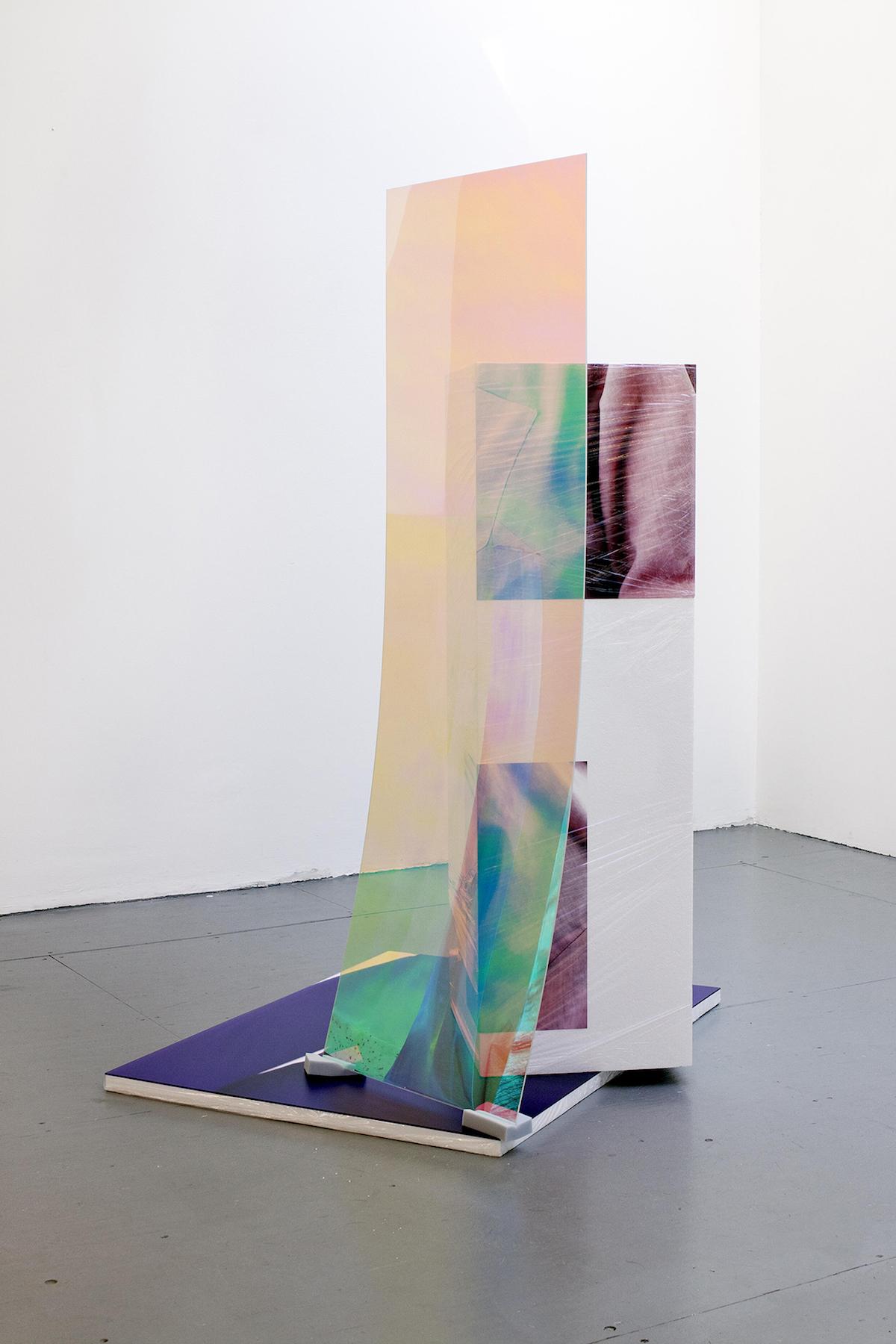 Sweaty Sculpture (back) , 167 x 90 x 107 cm, photo-stickers on polystyrene, cellophane, sponges, radiant plexiglass