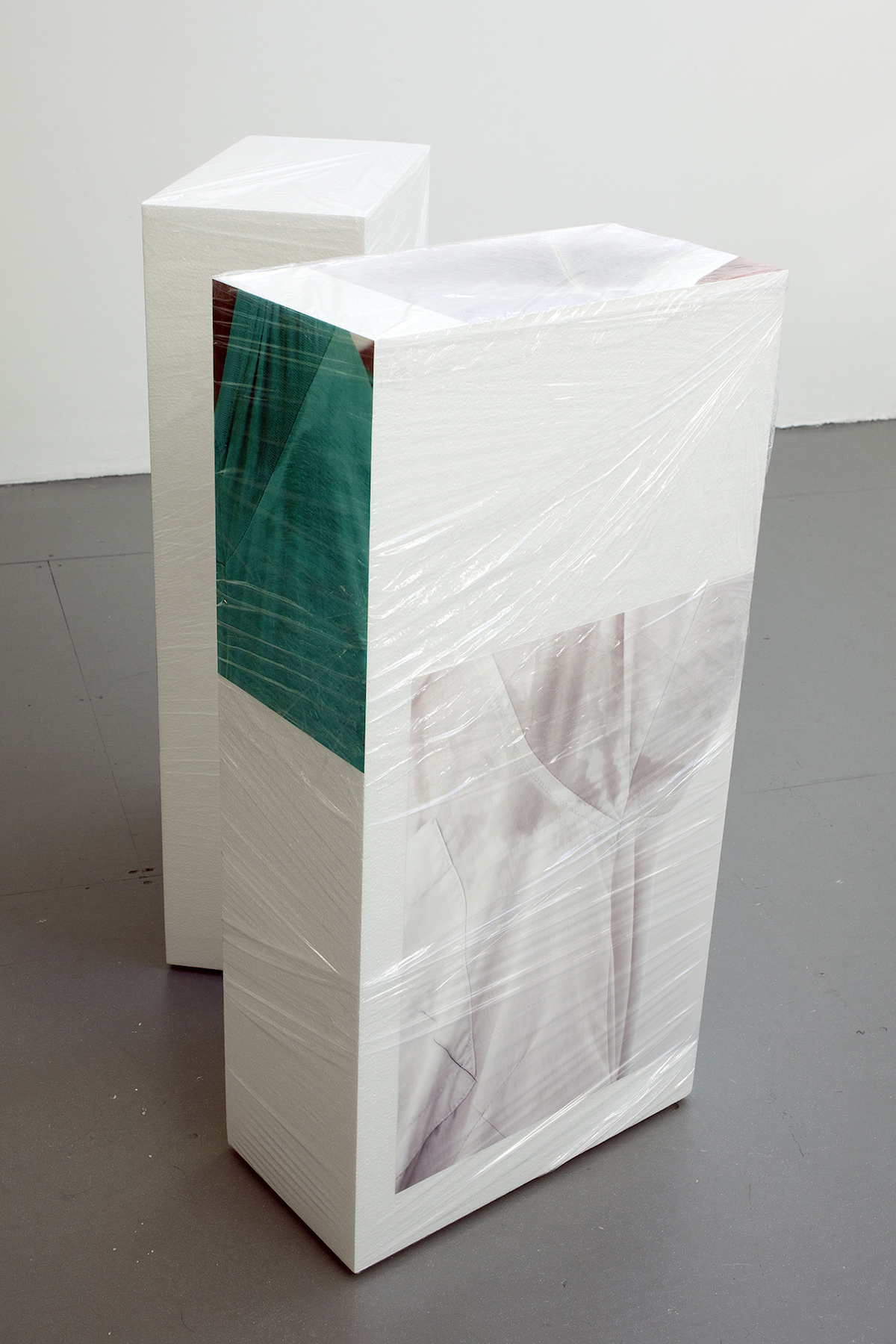 Sweaty Sculpture (front) , 101 x 65 x 100 cm, photo-stickers on polystyrene, cellophane, sponges, radiant plexiglass