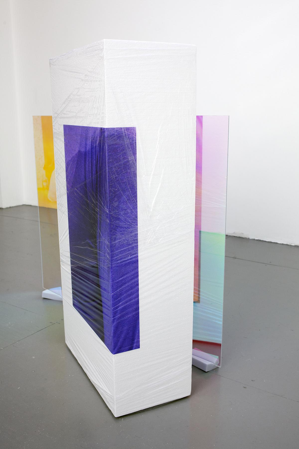 Sweaty Sculpture (uneven) , 115 x 110 x 102 cm, photo-stickers on polystyrene, cellophane, sponges, radiant plexiglass