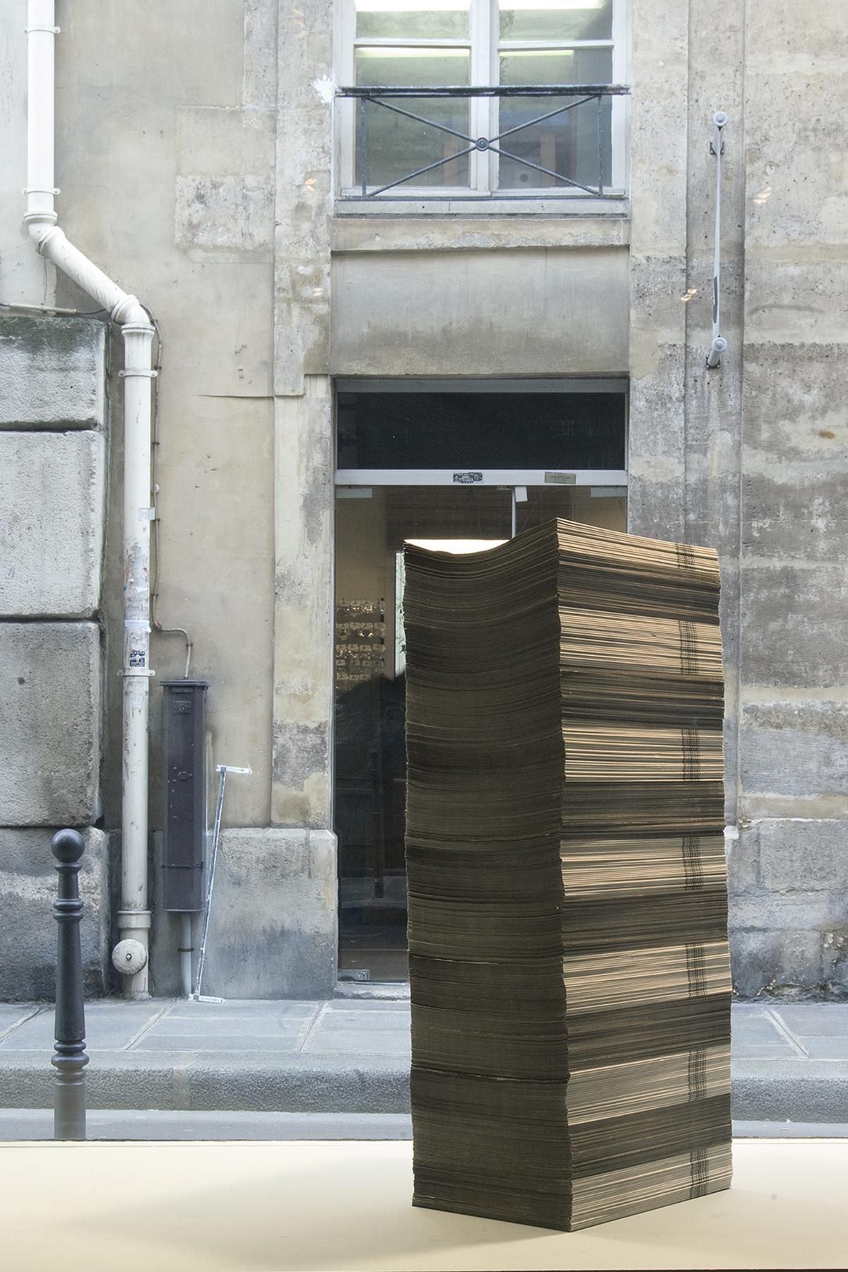 pile of newspapers at Le Petit Endroit Paris, 2012
