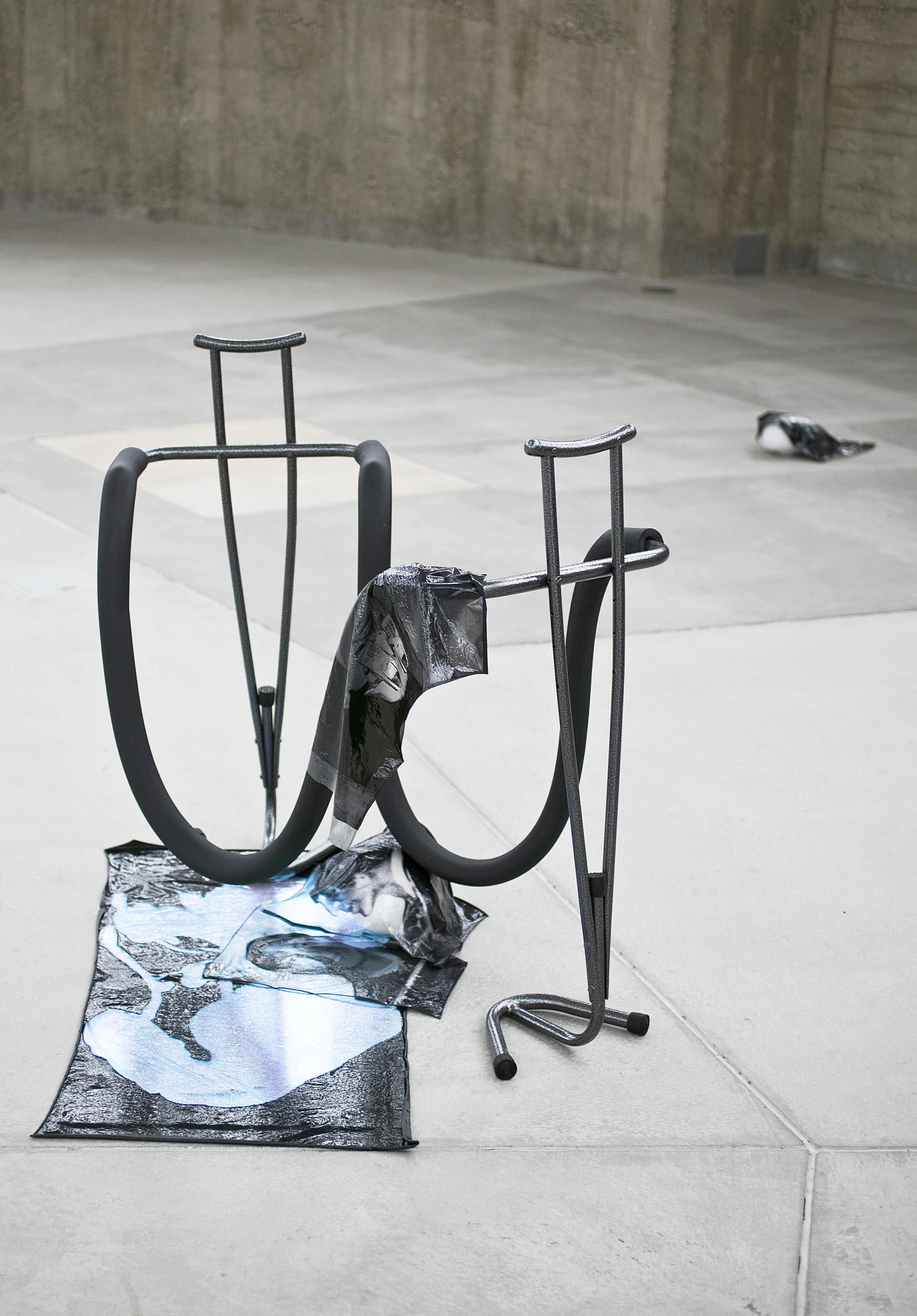 MIND(fool)NESS, 2017, Sculpture,103 x 117 x 63 cm,Inkjet prints on plastic, radiant plexi-sheet, crutches, rubber, metal, polystyrene, paint, bandage