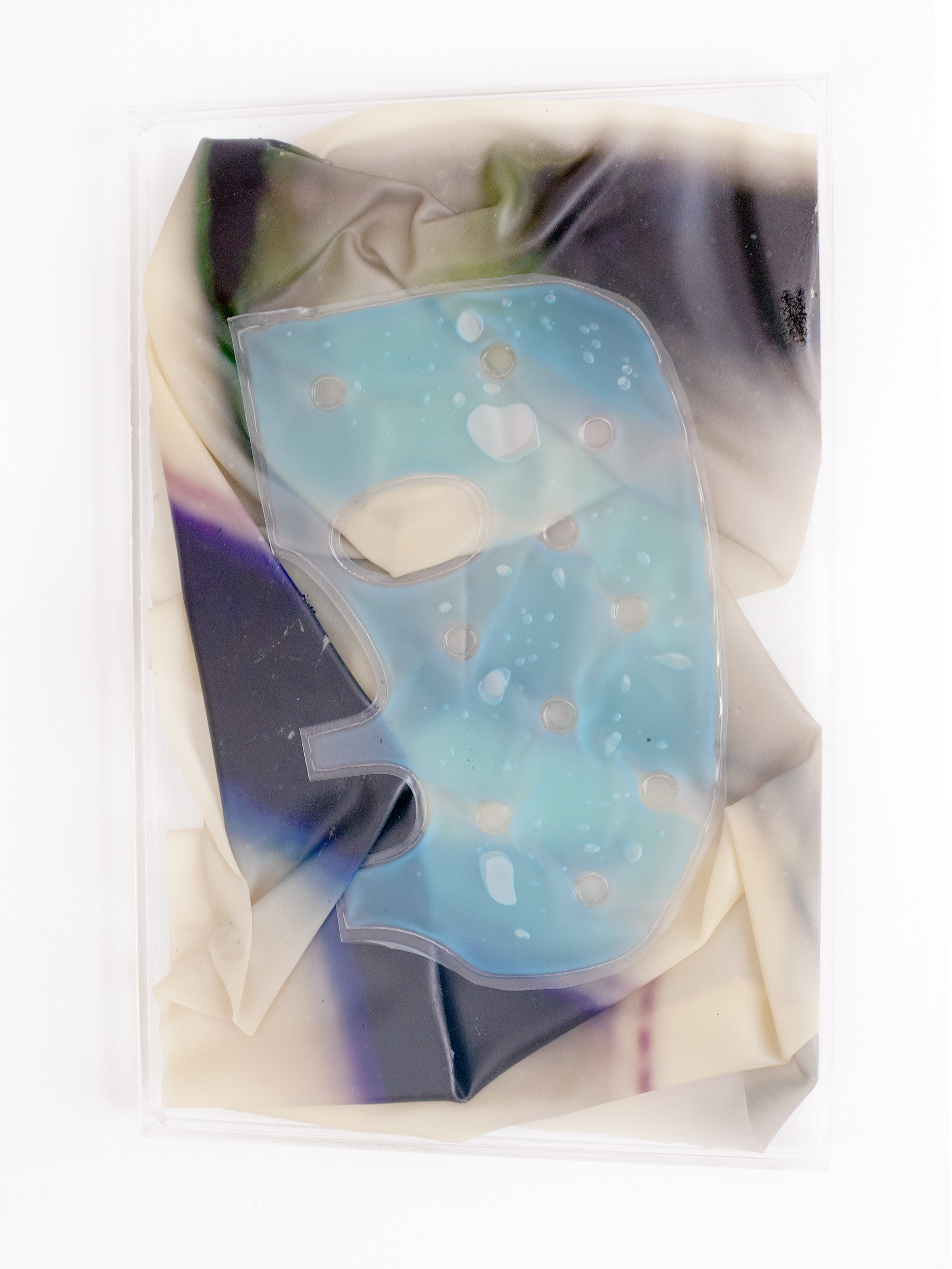 MOONSTRUCK,  2018, sculpture (unique), 30 X 20 x 1,6 cm, inkjetprint on latex, transparent acrylic, ½ face gel mask