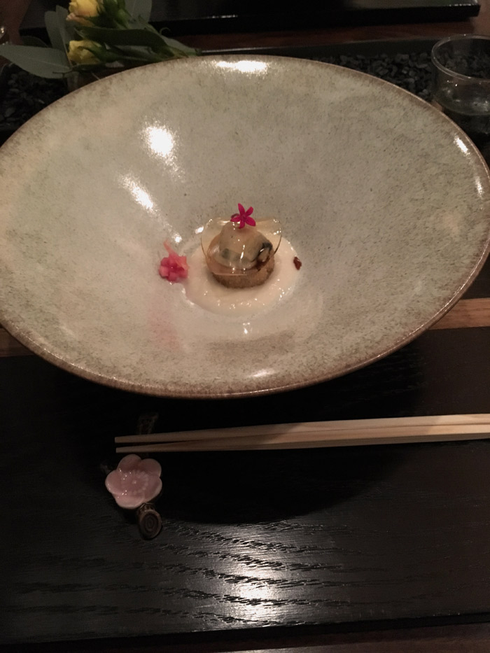 One of the 15 courses at n/naka. It was a seared scallop with a puree of some delicious sort and jelly.