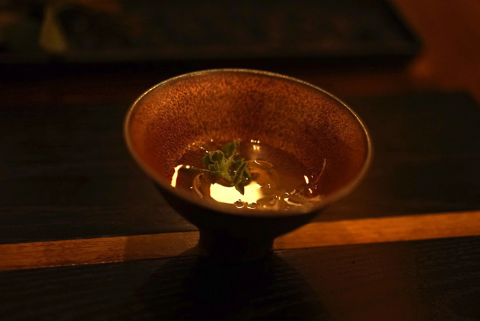 Dashi broth with clams and special crystal weed found on the side of road.