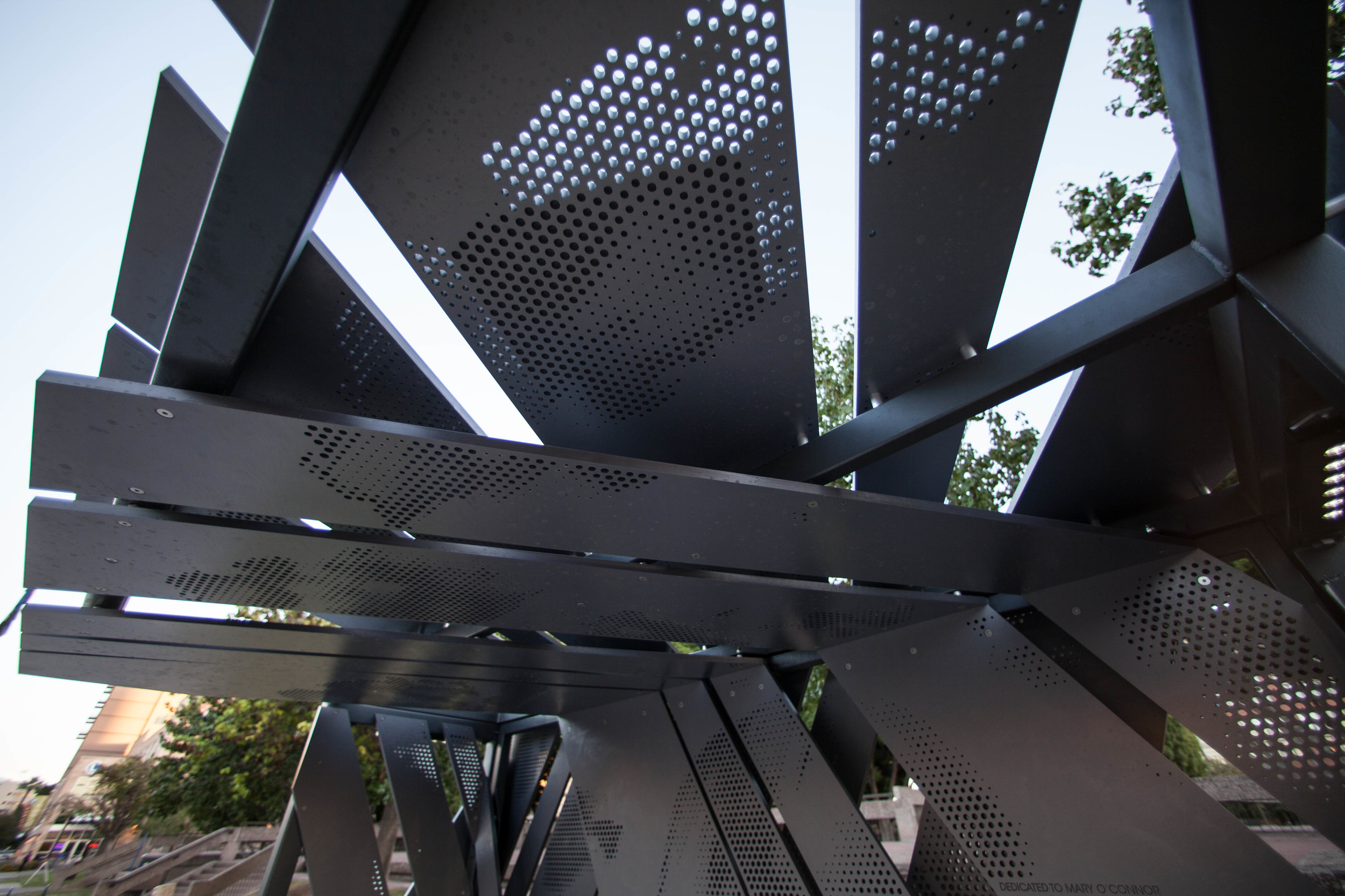 Memorial-transit-shelter-asteriskos-digital-fabrication-parametric-panel-wrapping.jpg