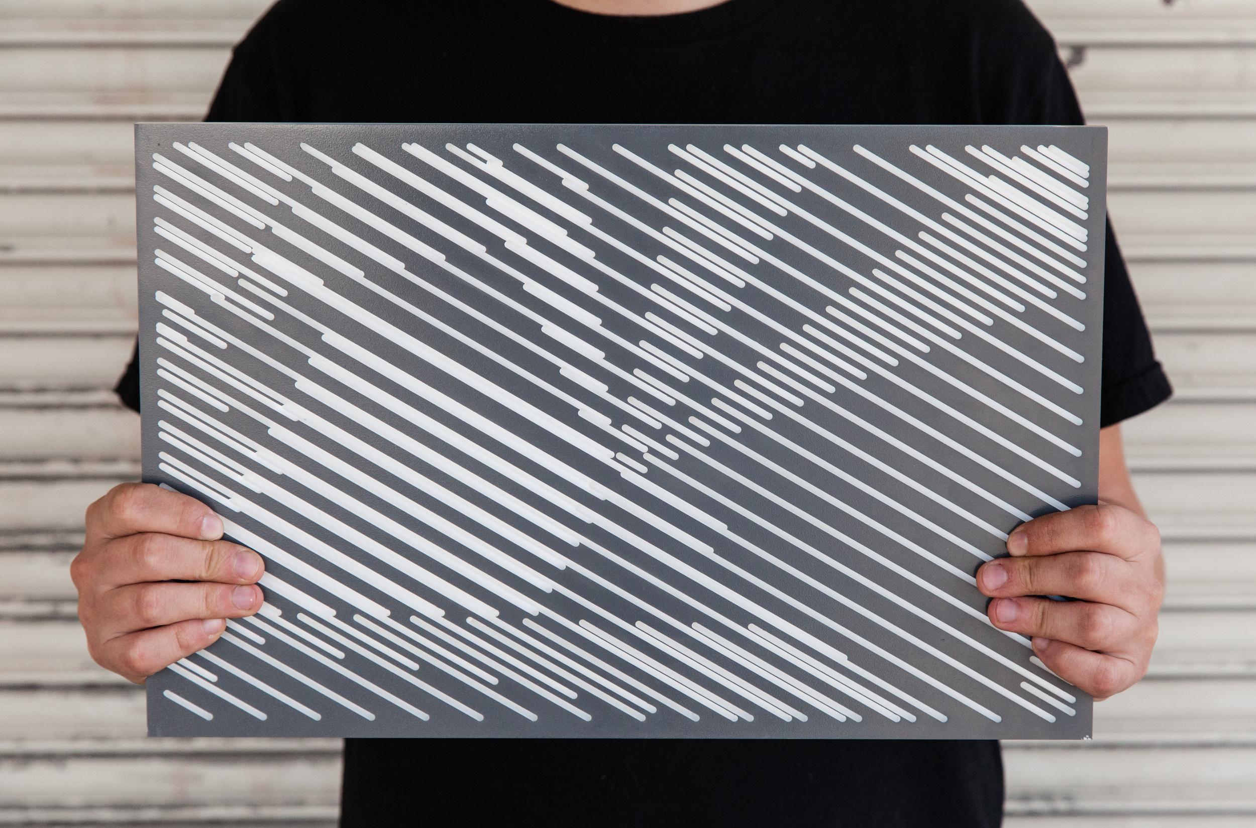 asteriskos-design-fabrication-cnc-art-solid-surface-graphic-pattern- hold.jpg