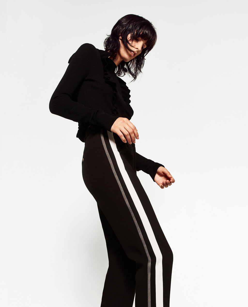 This 'new basic' ruffle jumper looks minimal but is an interesting way to wear a jumper and trousers. Who would have thought wool ruffles and stripes would work?  And for those of you who do have a corporate life...work these into your wardrobe this season. By  Haider Ackermann  -  an expensive way to work the trend.
