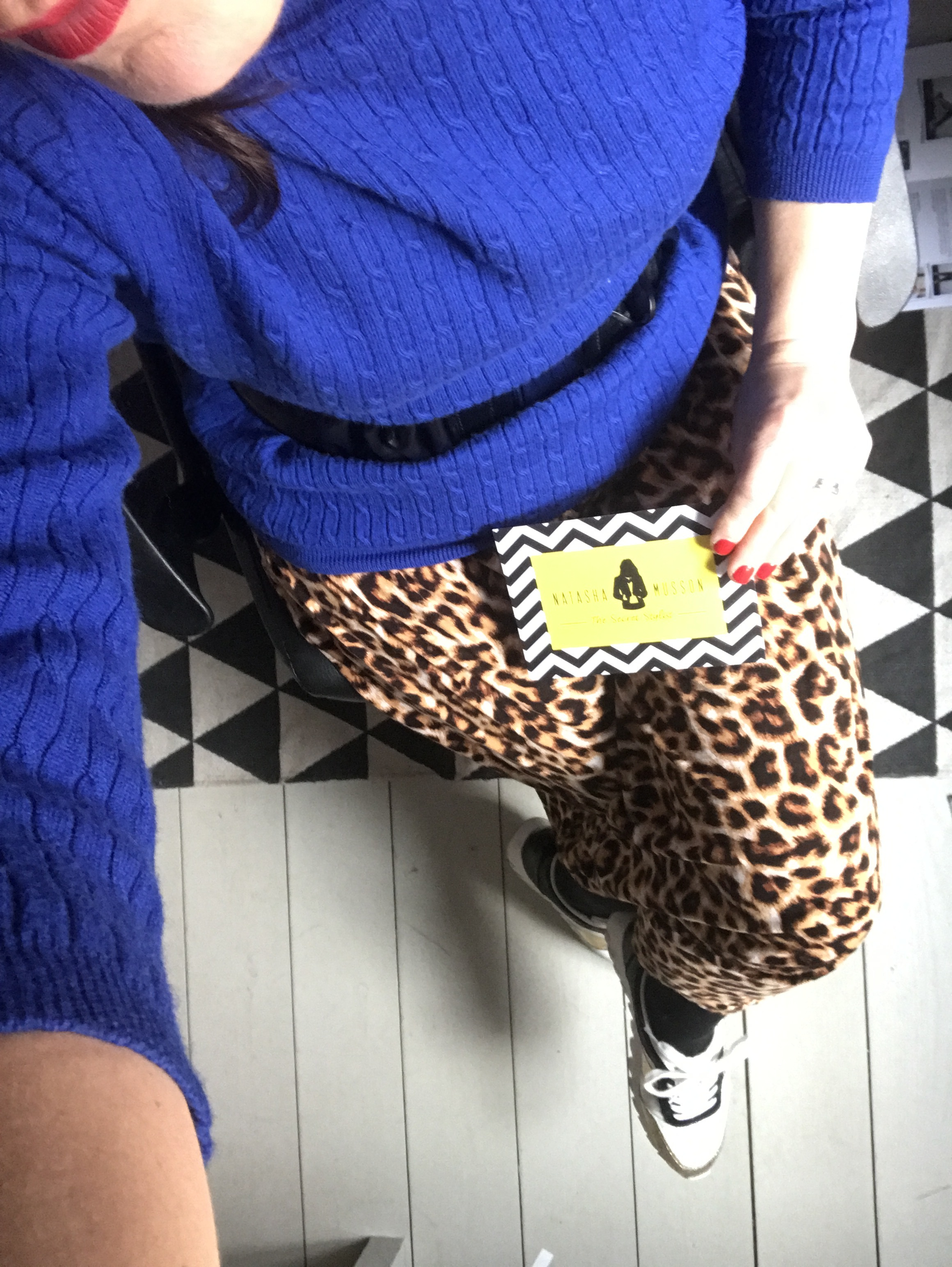 A summer midi leopard print is worn with tights, trainers and cobalt blue polo neck,