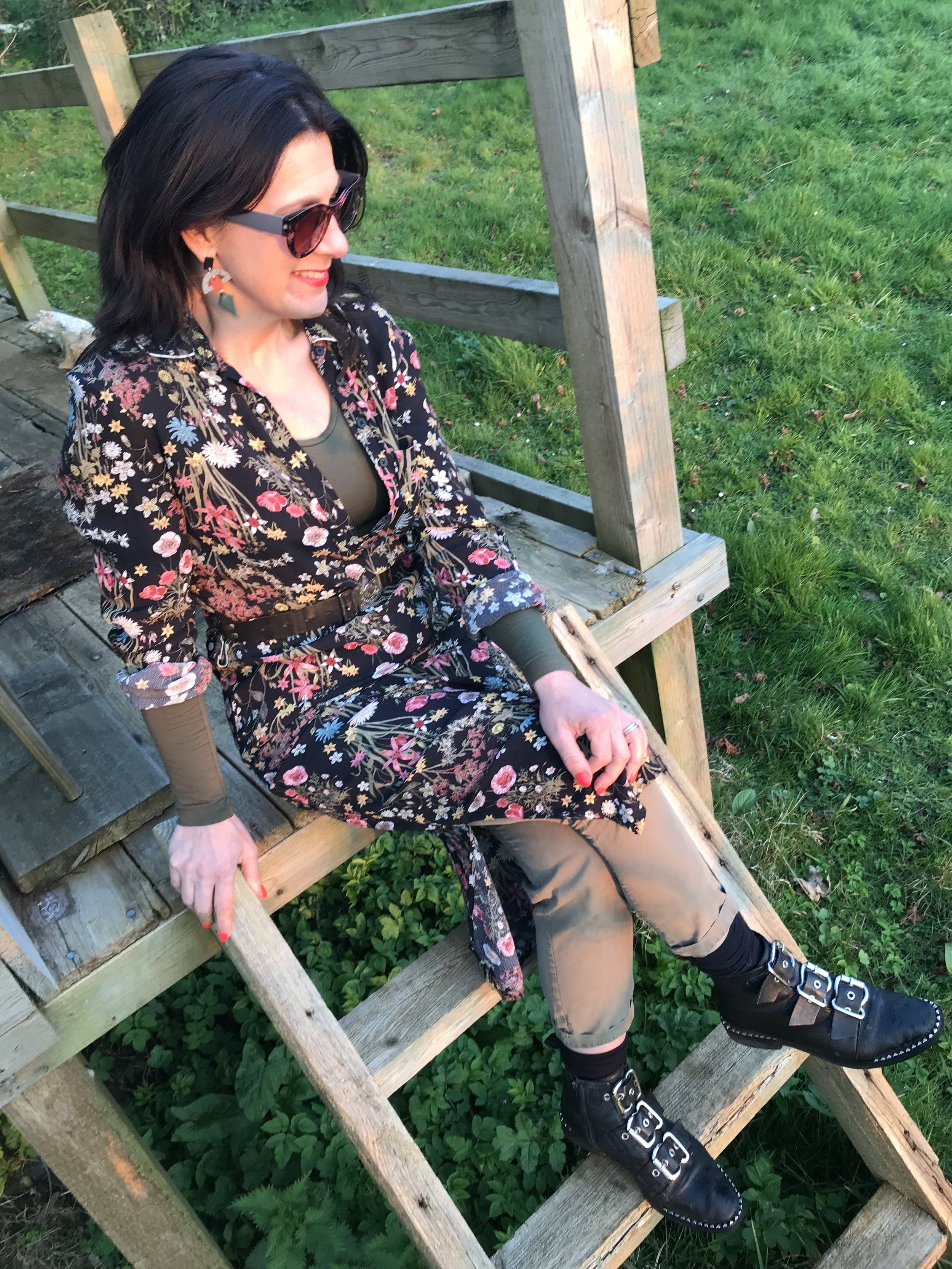 A floral midi over khaki mixed with biker boots