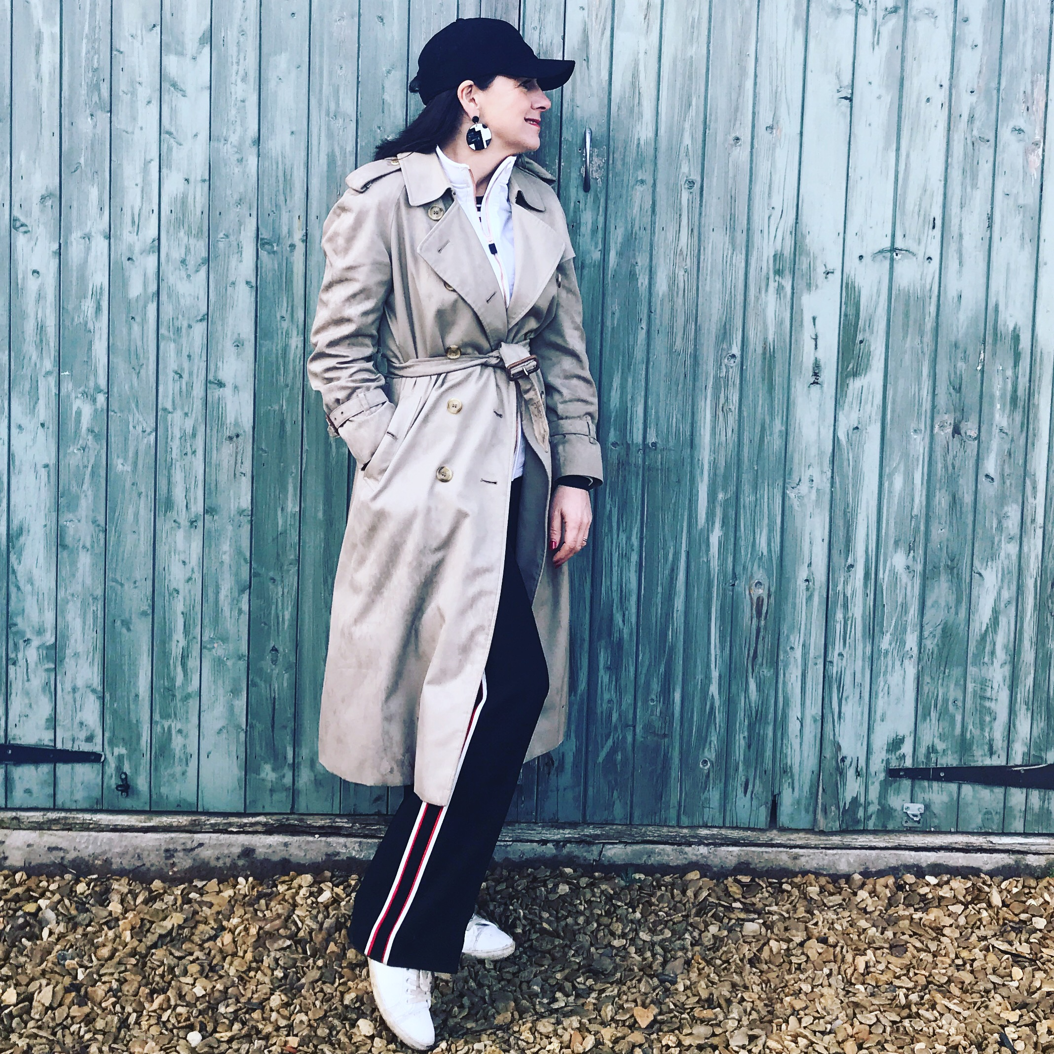 I've teamed my Boudavida Sports jacket under my trench for a sporty minimal city look. Wearing my striped trousers from &otherStories.