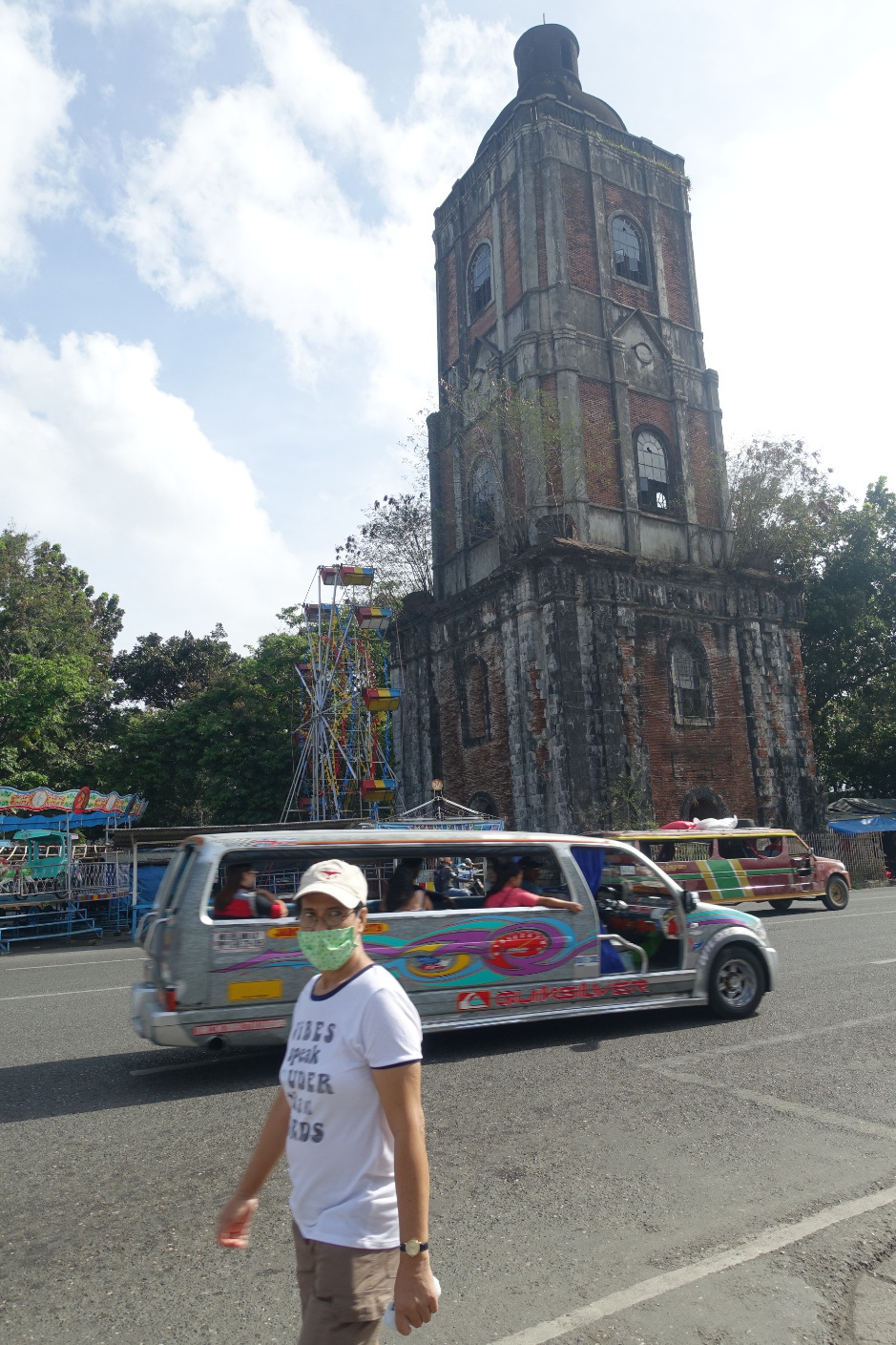 Iloilo contrasts: Jaro Metropolitan Cathedral and Jeepney transport vehicles