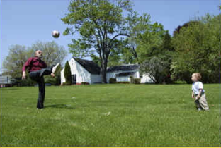 Horst playing soccer with grandson, 2006.