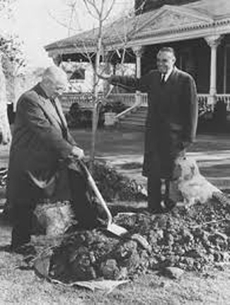 Harry Truman with the shovel.