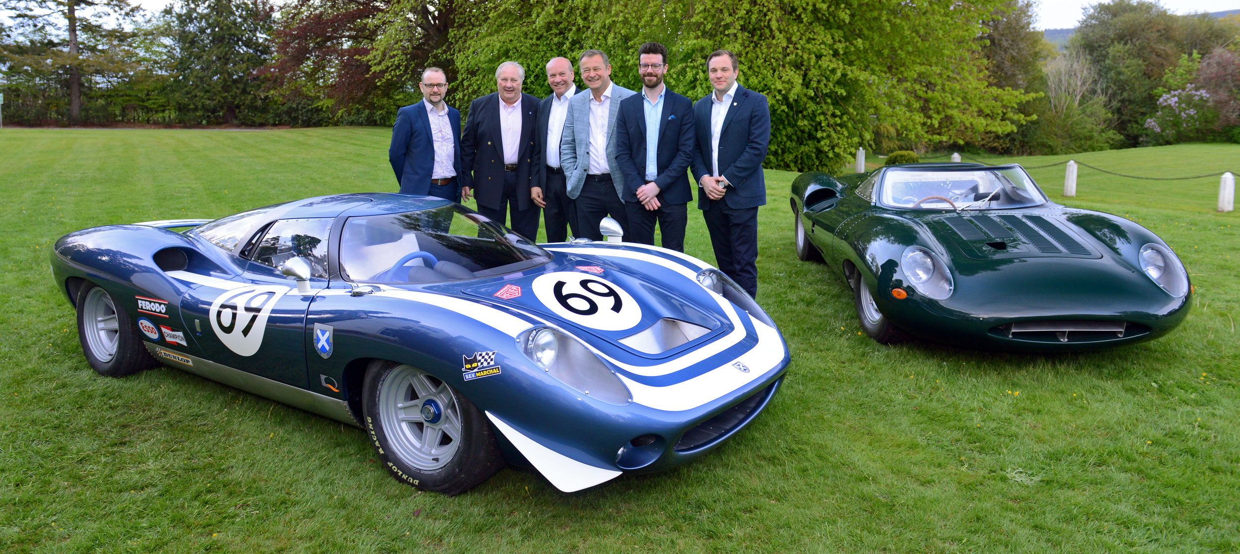 Left to Right: James Philpotts, Hugh McCaig, Neville Swales, Howard Guy, Patrick McCallion and Alasdair McCaig with the Ecurie Ecosse LM69 and Jaguar XJ13. Image courtesy of Fergusson Photography
