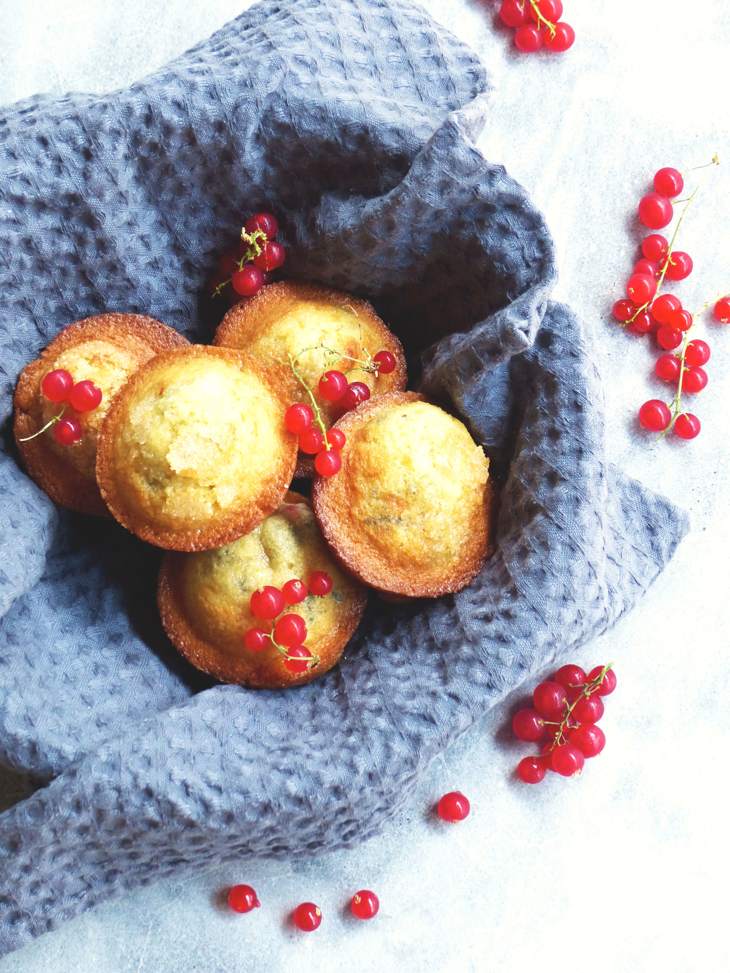 red currant muffins   Servings: 6 - 8 muffins    Preparation Time: 10 minutes    Cooking Time: 20 minutes    Ingredients:    2 cups All purposed flour  1/2 cup milk  4 tbsp butter at room temperature or melted  1 cup granulated sugar + 1 tbsp sugar for topping each muffin   1/2 tsp salt  1 tsp vanilla extract  2 tsp baking powder  2 eggs  1 handful red currant berries  1 lemon zest    Instructions:      1)   Preheat an oven at 200ºC.      2) Use a mixer to mix sugar, butter, and eggs in a large mixing bowl.    3) Add flour, baking powder, salt, milk, and vanilla extract, fold evenly.    4) Add berries and lemon zest.  Fold.      5)   Fill each greased muffin tin with batter.       ) Sprinkle some sugar on top of each muffin before going to the oven.     7) Bake for 15-20 minutes until the muffins turn golden.      8) Let the muffins cool for 2-3 minutes before serving.