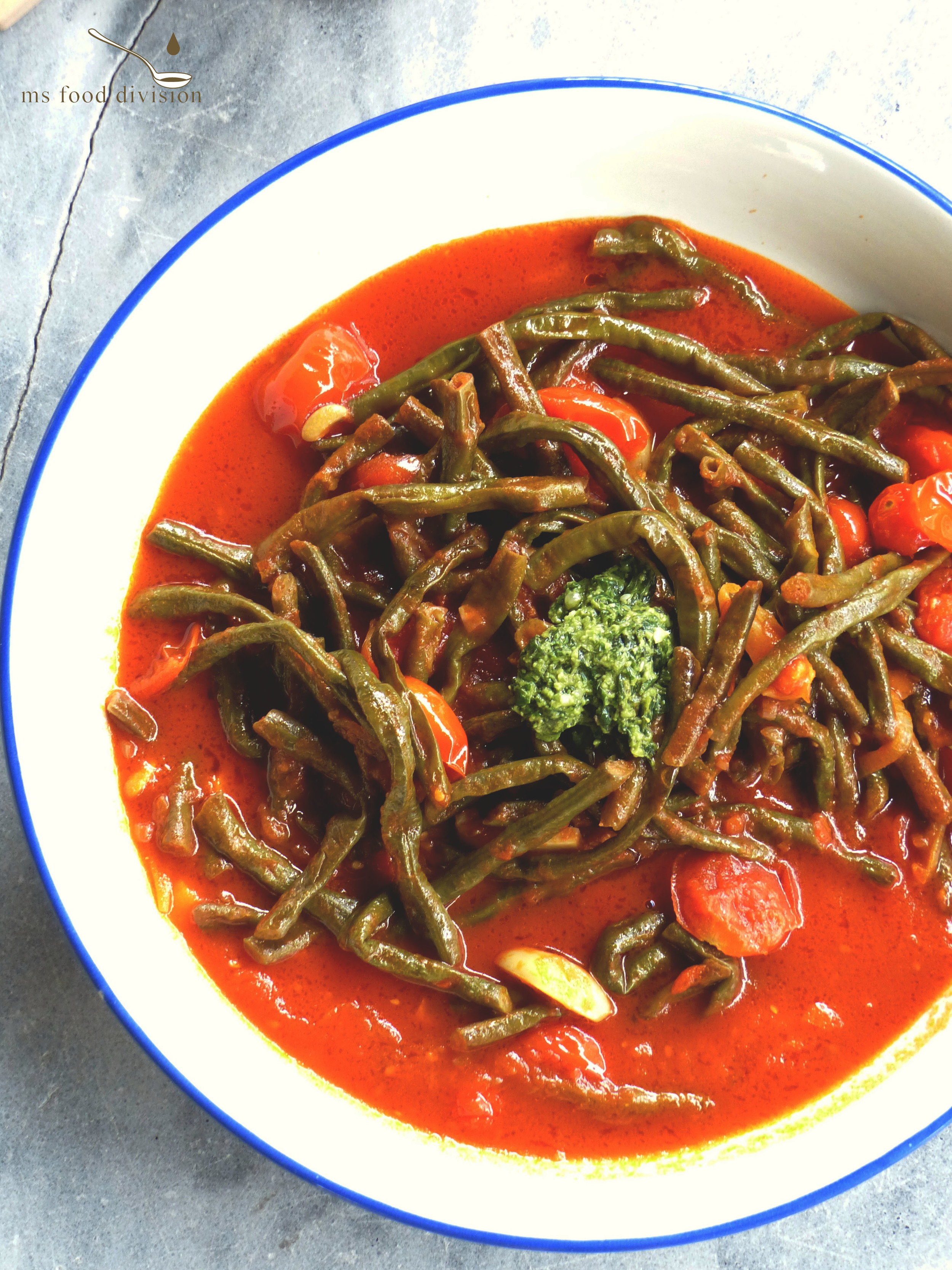 Servings: 2 persons    Preparation Time: 5 minutes    Cooking Time: 30-40 minutes    Ingredients:   300g long green beans  150g-200g cherry tomatoes, halved  3-4 shallots, thinly sliced  4-5 garlic cloves, chopped  2-3 tbsp tomato paste  2 cups vegetable stock  1/2 glass white/red wine  2 tbsp sherry vinegar  1 tbsp brown sugar  extra-virgin olive oil