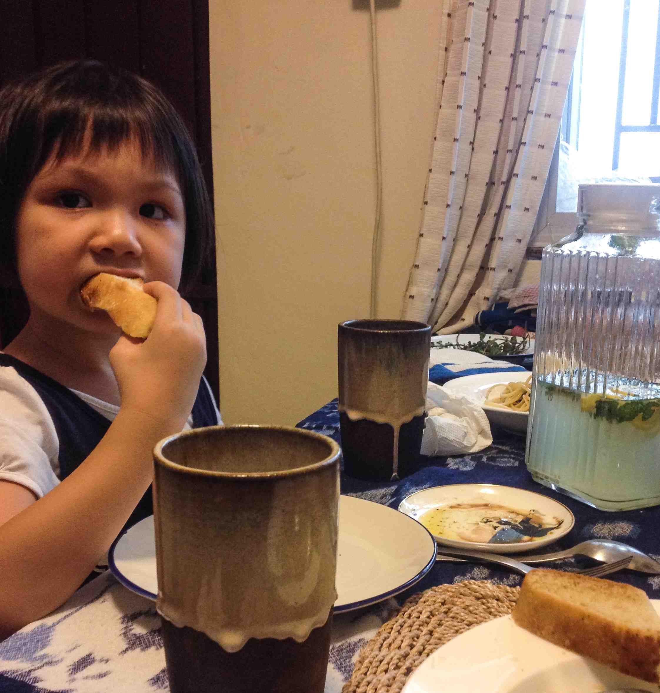 Alicia, my niece, is loving her bread. :) Such a satisfying moment.