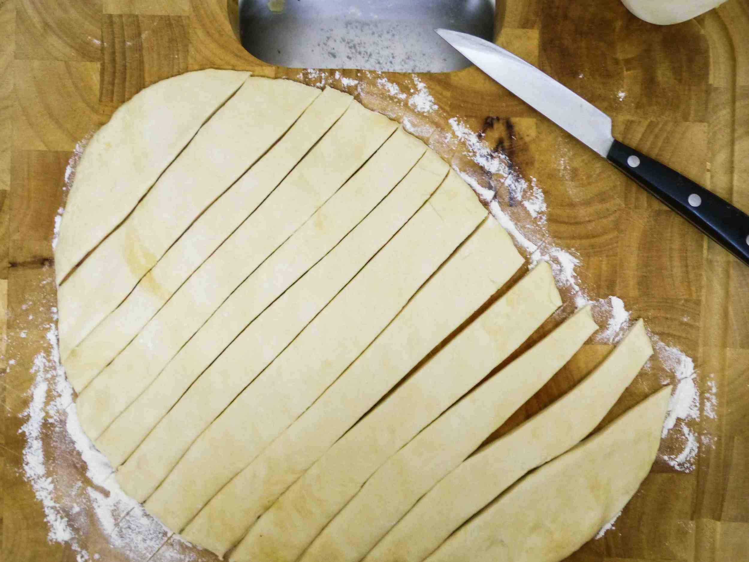 After rolling out the dough to a flat sheet, cut the sheet into 10-12 strips.