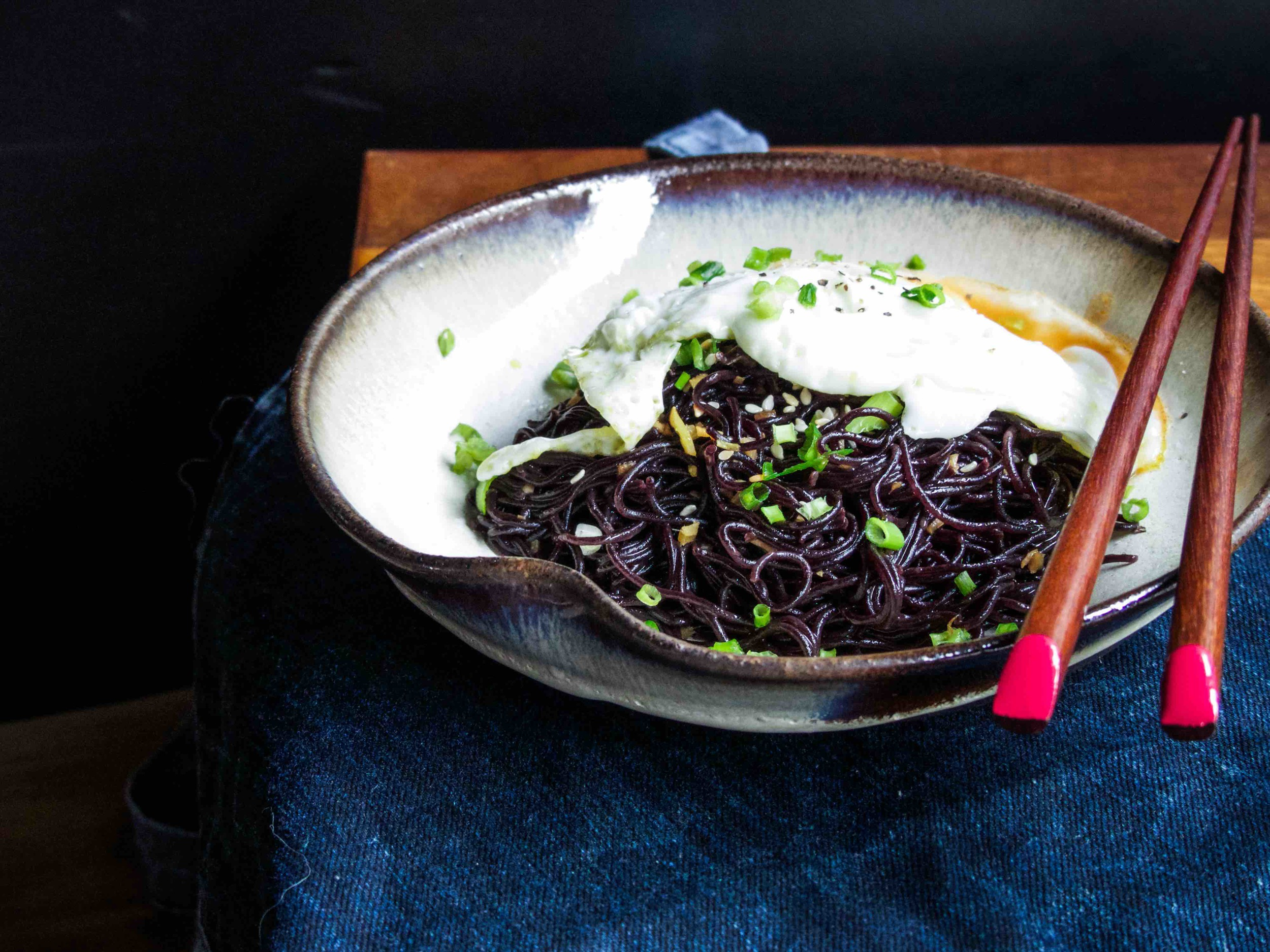 "Recipe for ""the budget ramen dish""    Servings: 1 person  Preparation Time: 2 minutes  Cooking Time: 3-4 minutes   Ingredients:    1 black rice ramen cake, cooked according to the packaging label (3 minutes)  1/2 garlic clove, finely chopped  1 tsp grated fresh ginger  1 tbsp chopped spring onion  2 tbsp soy sauce  1 tbsp honey  1 tsp rice vinegar  1 tsp sesame oil  1 tsp sesame seeds  1 egg, sunny side up  hot sauce    Instructions:      1) To make the sauce to go with the cooked ramen, simply add sesame oil, soy sauce, honey, rice vinegar, garlic, and ginger.  Mix well.      2) Coat the ramen with sauce and add an egg.  Garnish with sesame seeds and spring onion.  Add a dash of hot sauce to give an extra kick of this simple dish before serving."
