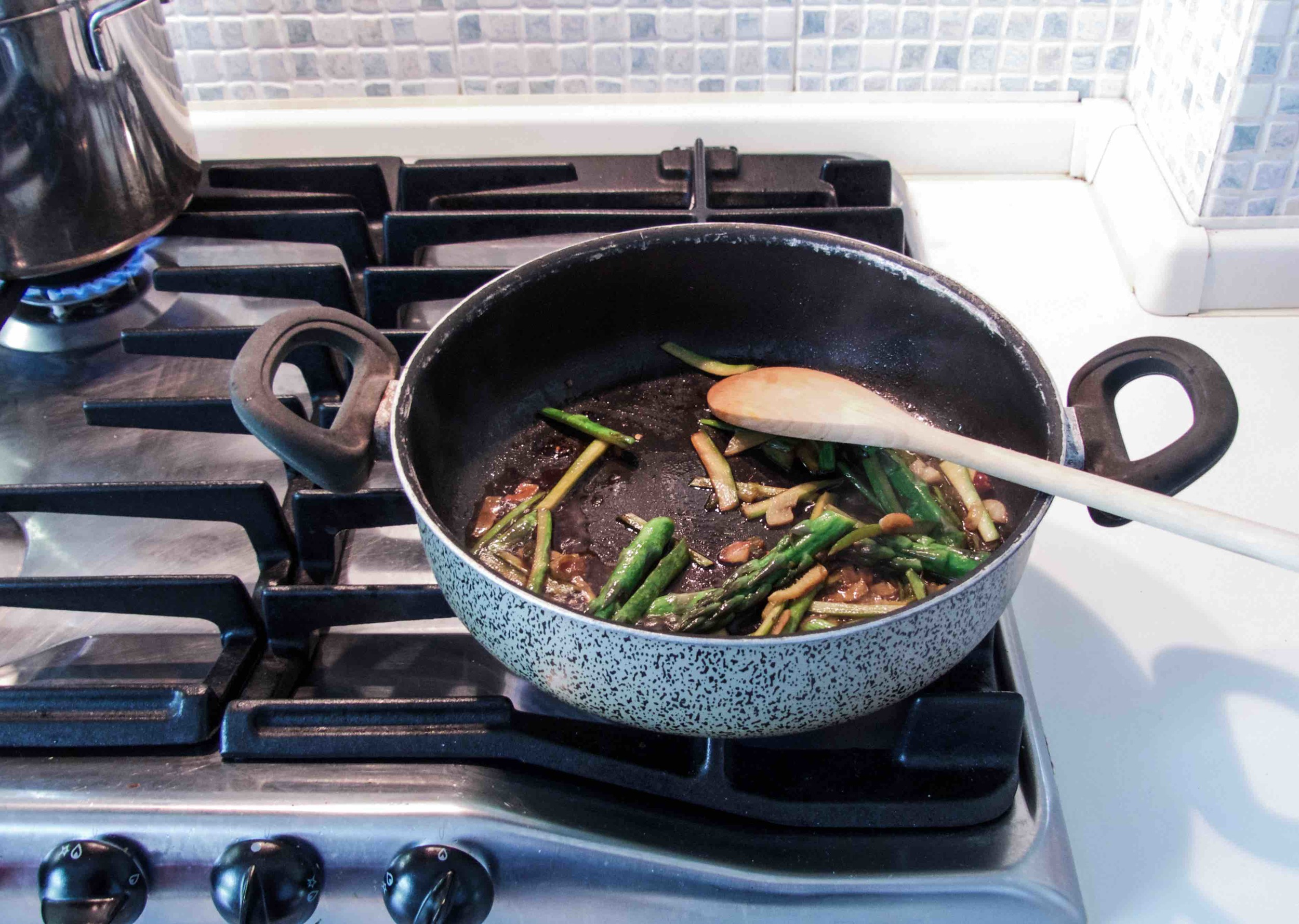 Instructions:   1) Cook soba according to its packaging label.  After soba is cooked, rinse with cold water and drain well.  Set aside.  2) Preheat a saucepan with 2-3 tbsp oil on medium-low heat, cook chopped garlic, spring onion, chilli, and ginger 1-2 minutes.    3) Stir in asparagus and mirin.  Cook 1-2 minutes.    4) Add water and soy sauce, put a lid on and let the vegetables cook 3-5 minutes.    5) Add soba and mix well.  Season if necessary.  Heat off.   6) Garnish with some sesame seeds, radish, chopped spring onion, and a drizzle of sesame oil before serving.