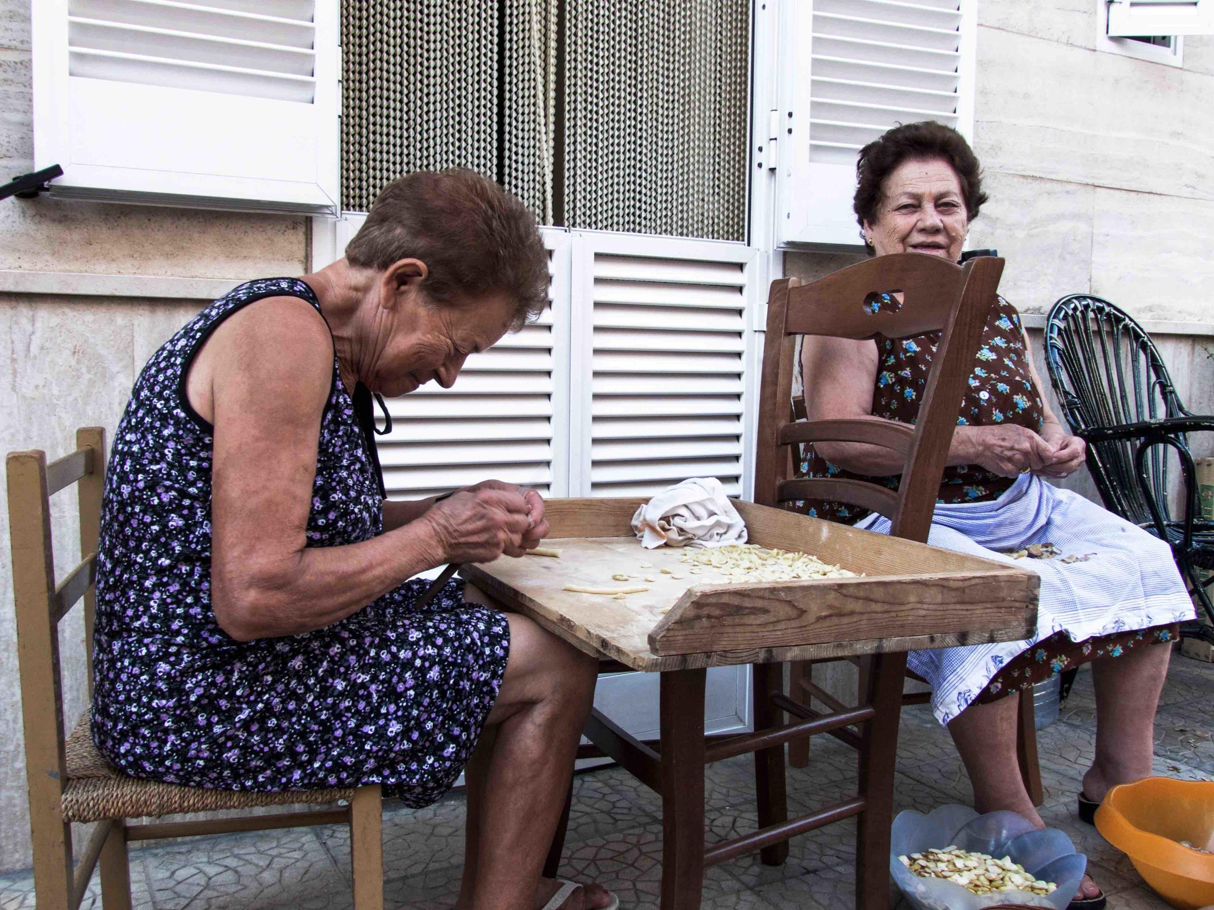 Nonne making children-sized orecchiette for their grandchildren.