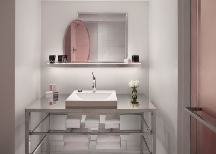 The use of rose-pink accents against ultra-clean lines of shiny chrome and bright white fixtures, really bring a sense of European elegance, along with a touch of whimsy.