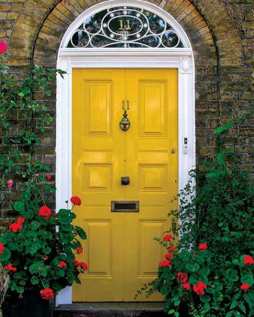 A sunny yellow door is so warm and welcoming, and looks great with so many other colors. And the transom above is very whimsical!