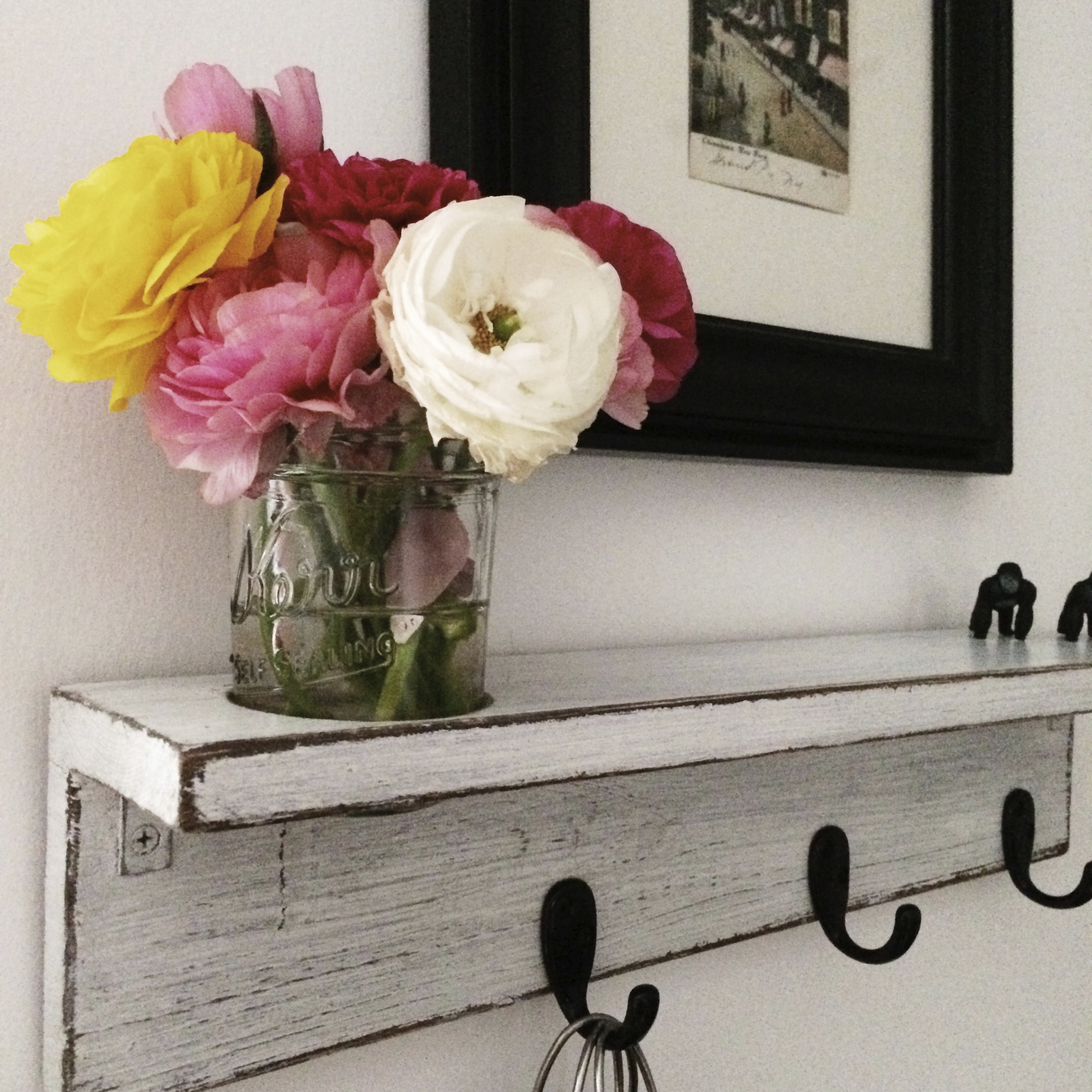this shelf, and the cutout for a jar of flowers. (and those tiny gorillas creeping up in the corner.)