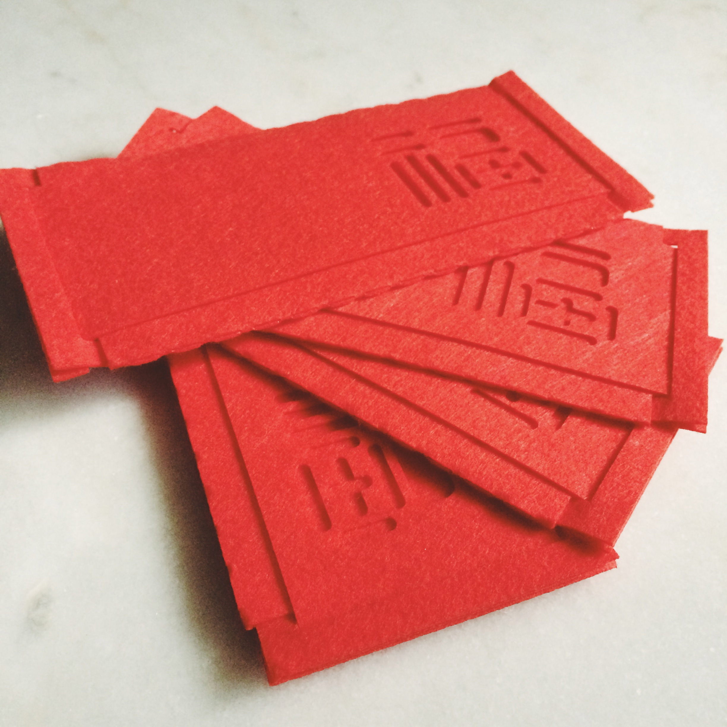 red envelopes in felted wool. people  love  these.