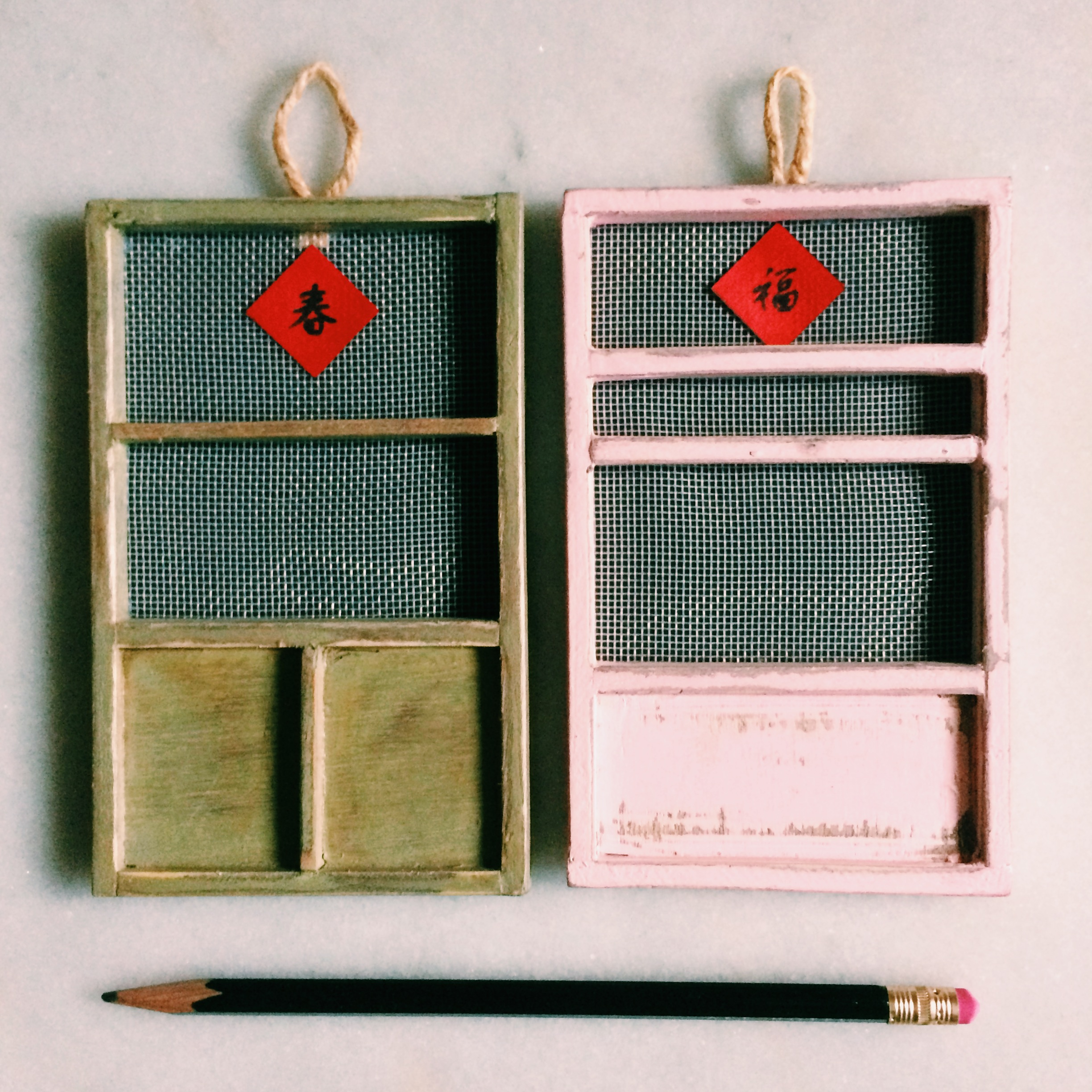 tiny replicas of traditional taiwanese doors that remind me of the ones at my grandparents' house.