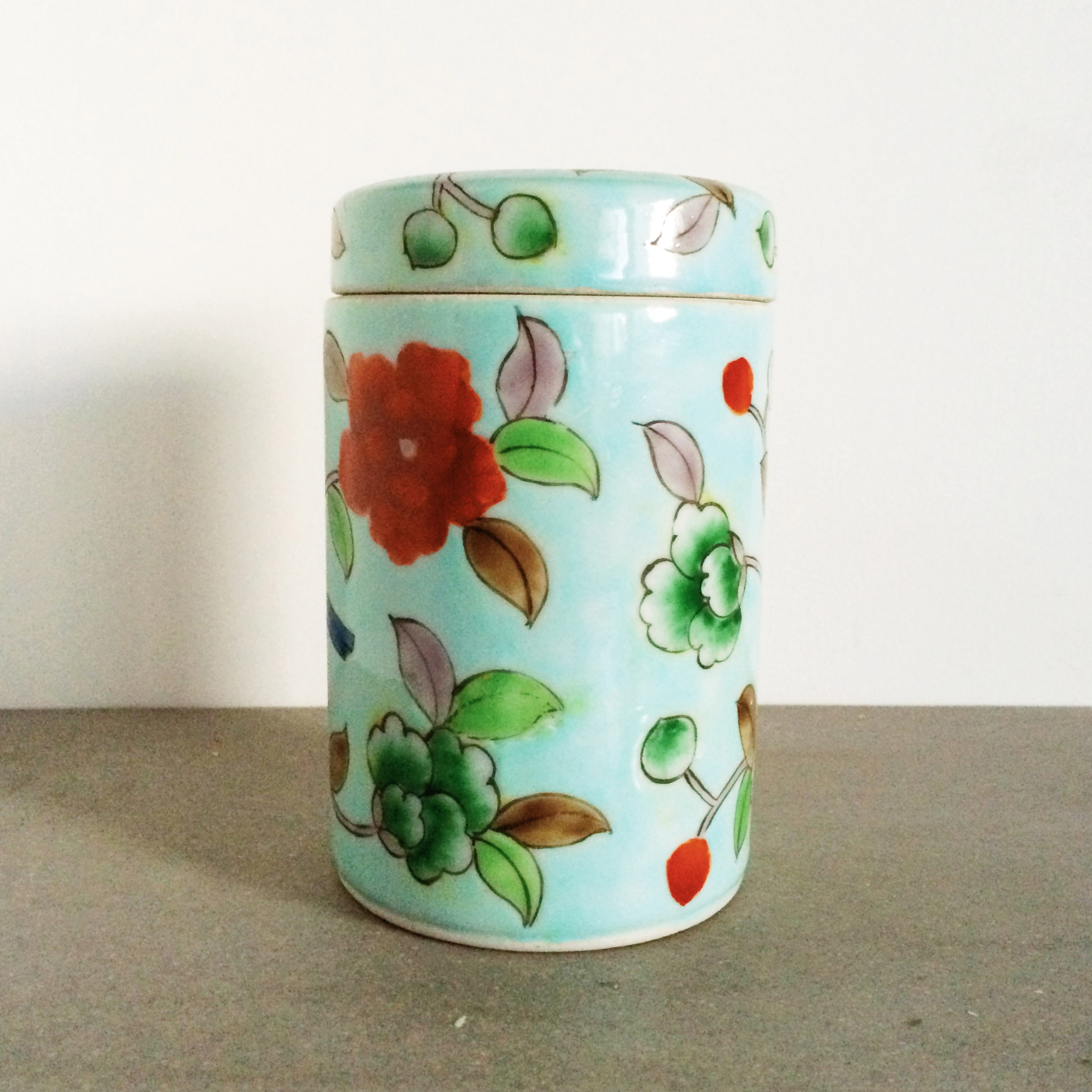 a petite ceramic container from the basement of  laitai flower market  in beijing, currently housing q-tips and cotton balls in my bathroom.