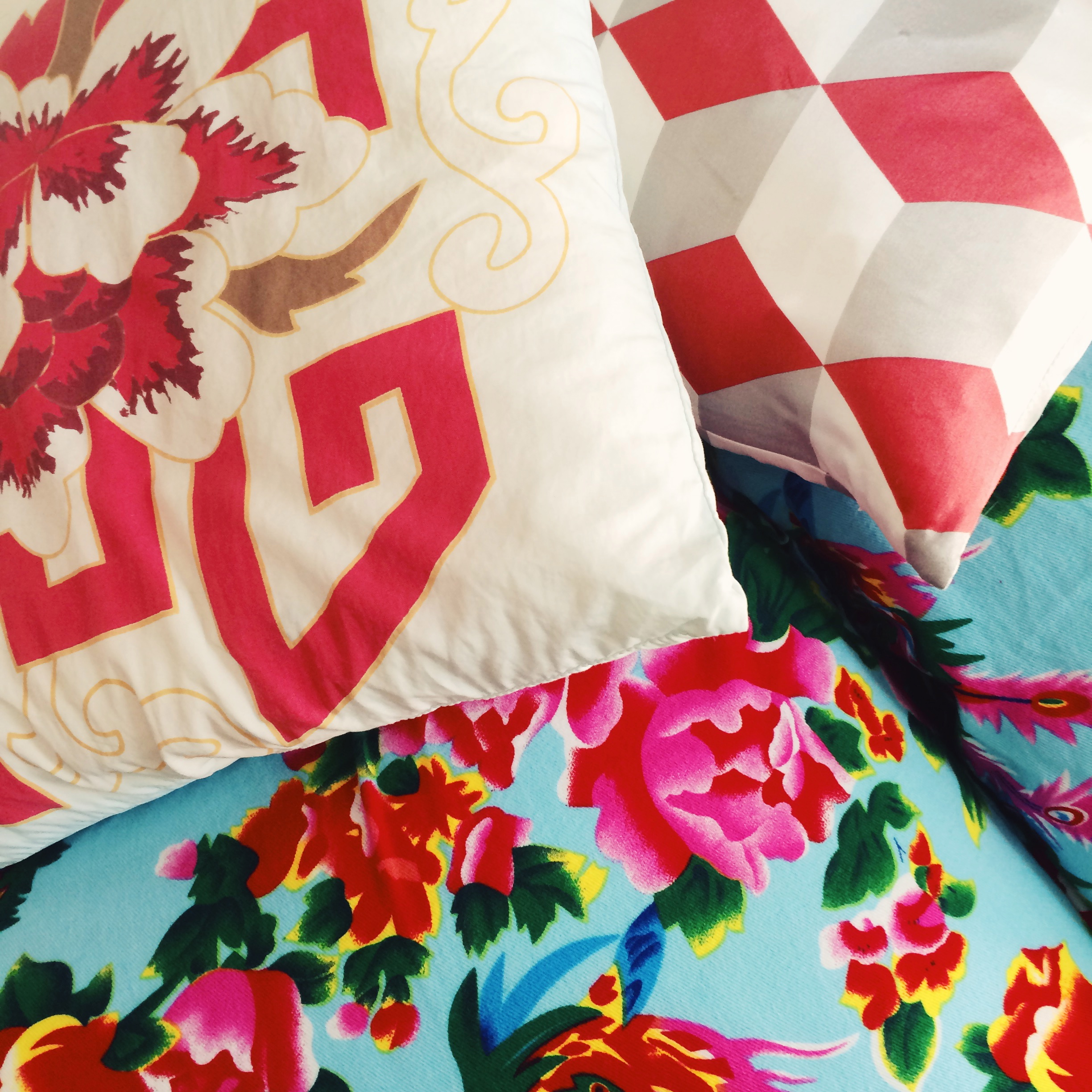 these bright patterns...including the blue Chinese flower print, custom-made in beijing.