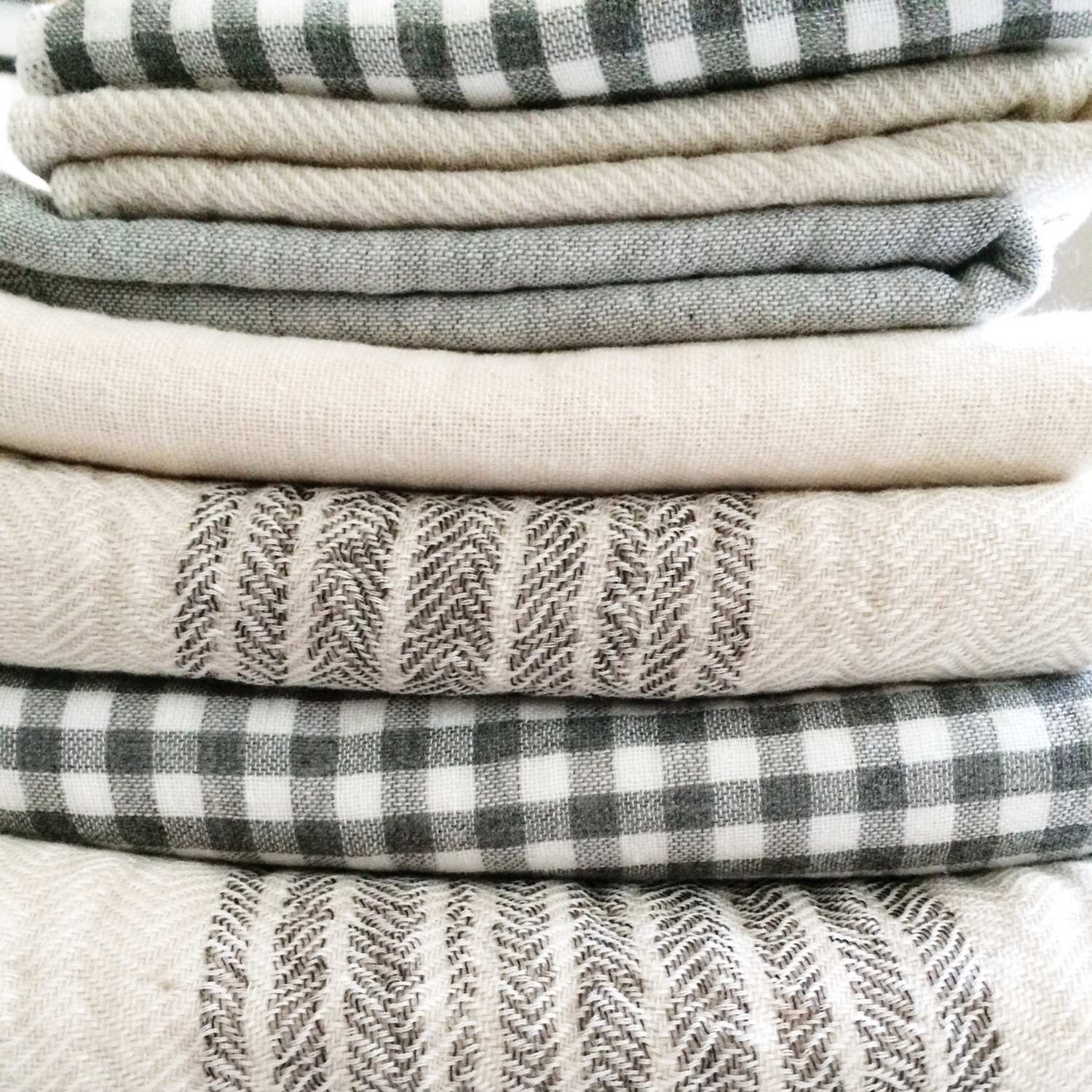 a stack of  kontex  and hartwell bath towels made in  imabari , all woven cotton on one side and terrycloth on the other.