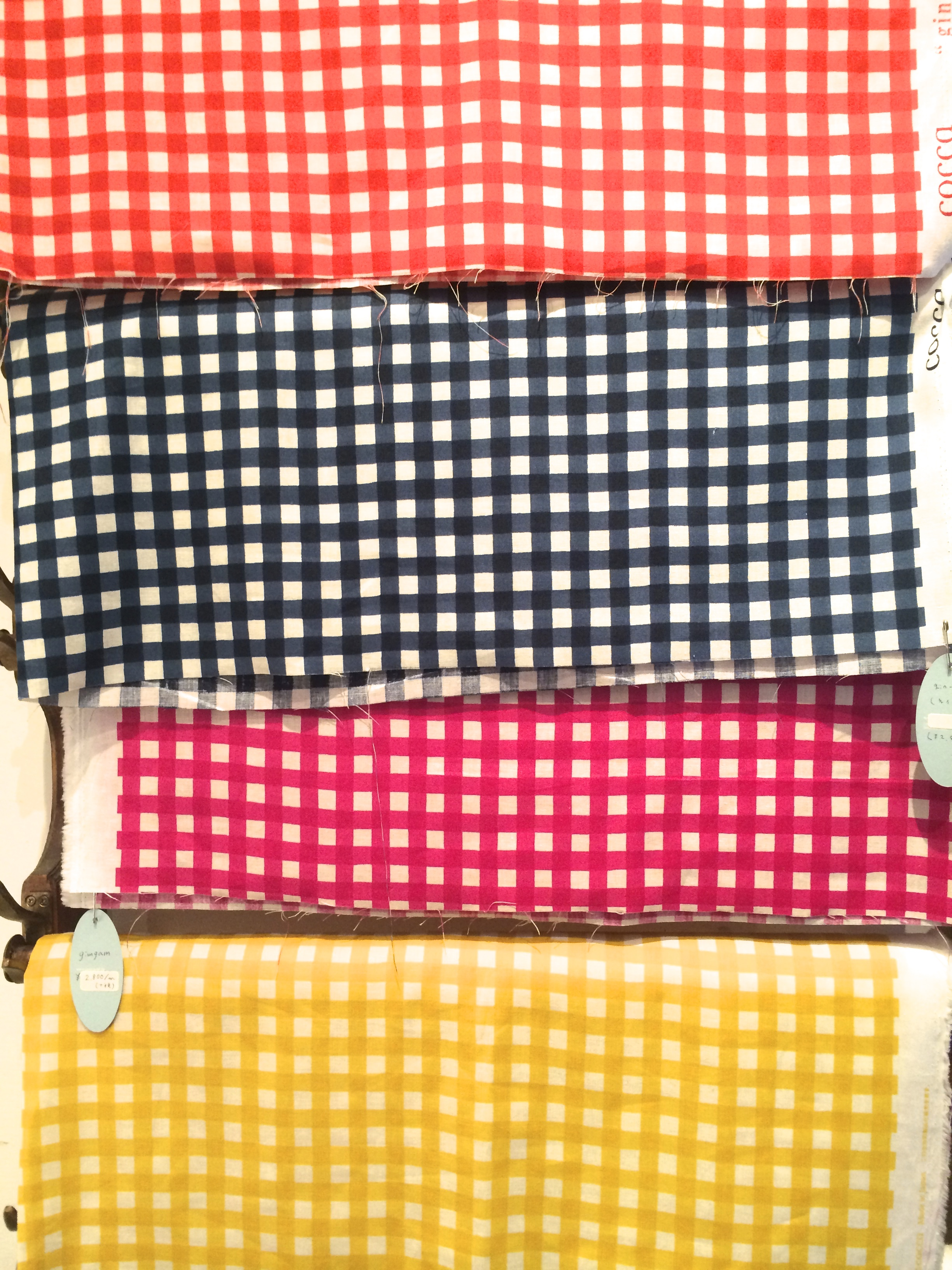 a close-up of cocca's gingham patterns.