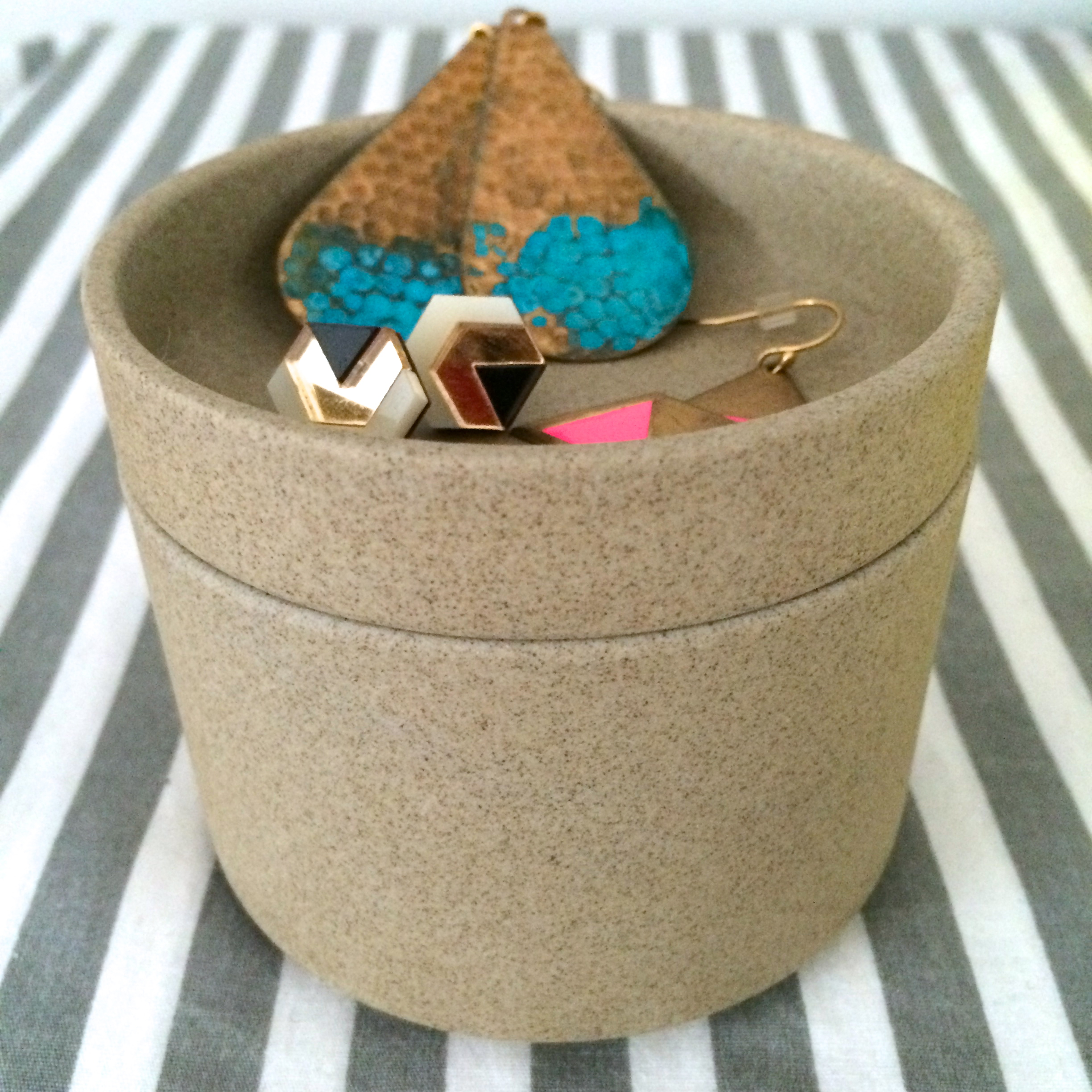 this mini  hasami  plate and bowl, repurposed for jewelry.