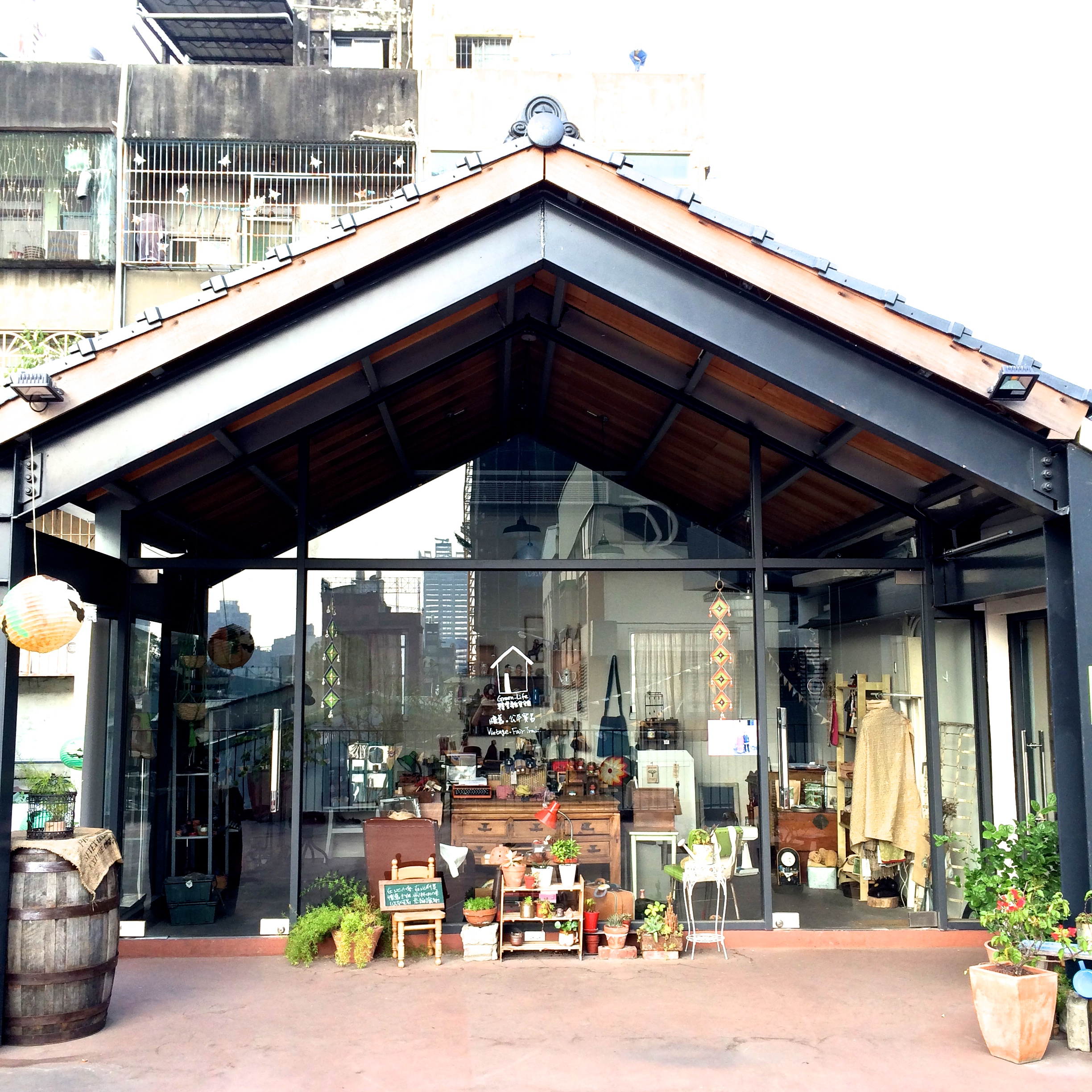 a gift shop on the second floor of the second building.