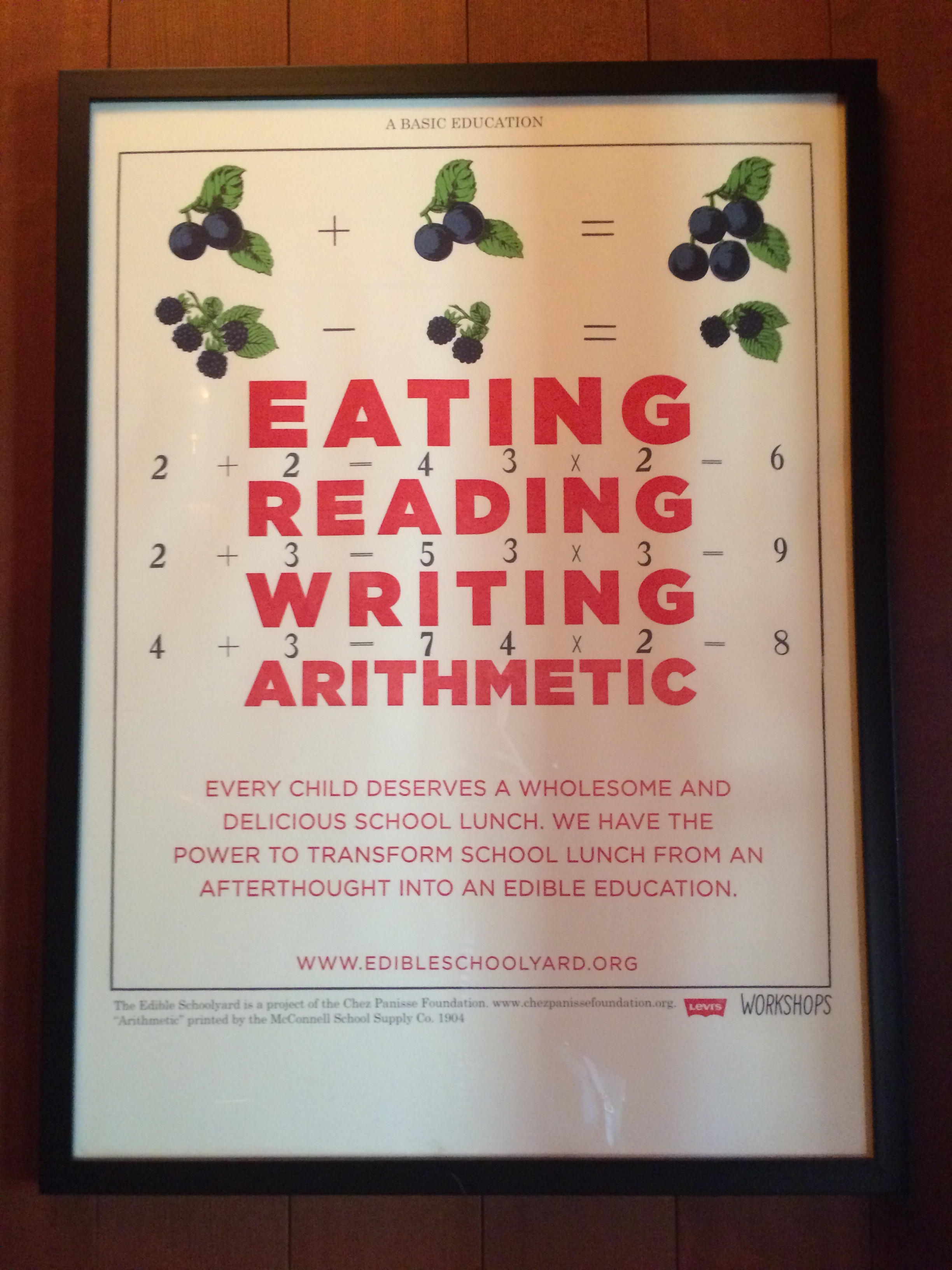 a poster in the entry featuring alice waters' foundation, edible schoolyard.
