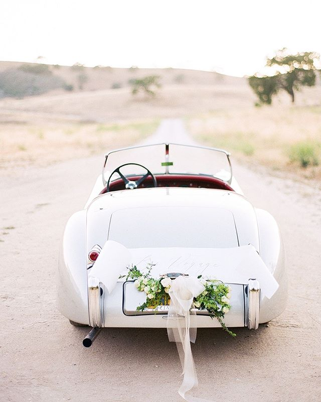 We've had a two month hiatus from Instagram, but we're back and felt this photo by @mikelarson from Ellie & Brett's @kestrelpark wedding was the perfect image to get back in gear.  Floral Design: @cocorosedesign. Stationery: @lotusandash. Vintage Jag: @winningmakes. Venue: @kestrelpark.
