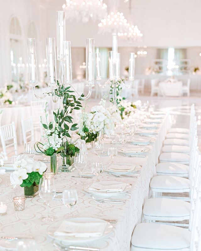 All white with a touch of organic greenery for Emily & Bradford's black tie wedding at @rosewoodmiramarbeach.  Photography: @charissamagno. Floral Design: @hoguefloral. Rentals: @tacer_losangeles. Lighting: @bellavistadesigns. Linens: @latavolalinen. Stationery: @paulaleecalligraphy. Dance Floor: @rcddancefloors.
