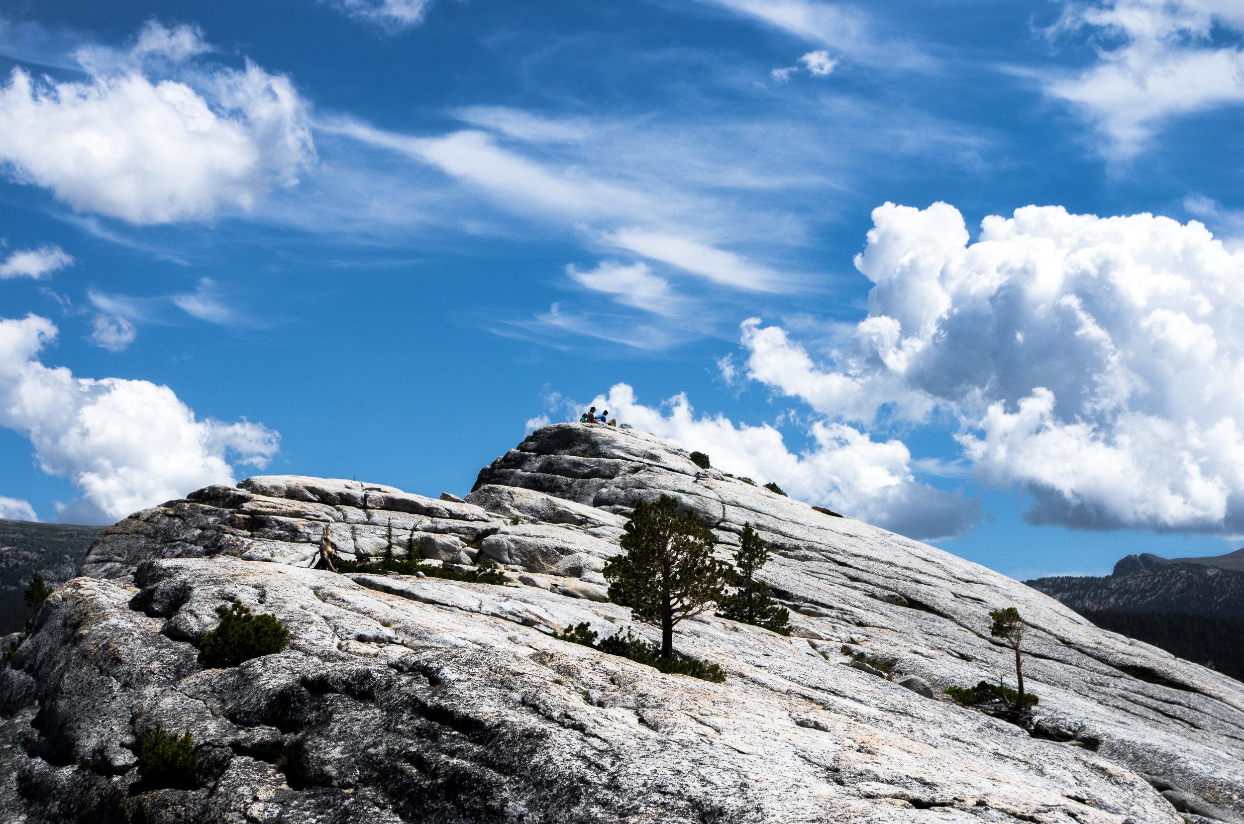 Hikers atop Lembert Dome. Tuolumne Meadows, Yosemite National Park, CA