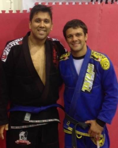 Receiving my blue belt in BJJ from Nova Uniao's Robson Moura in October 2013.
