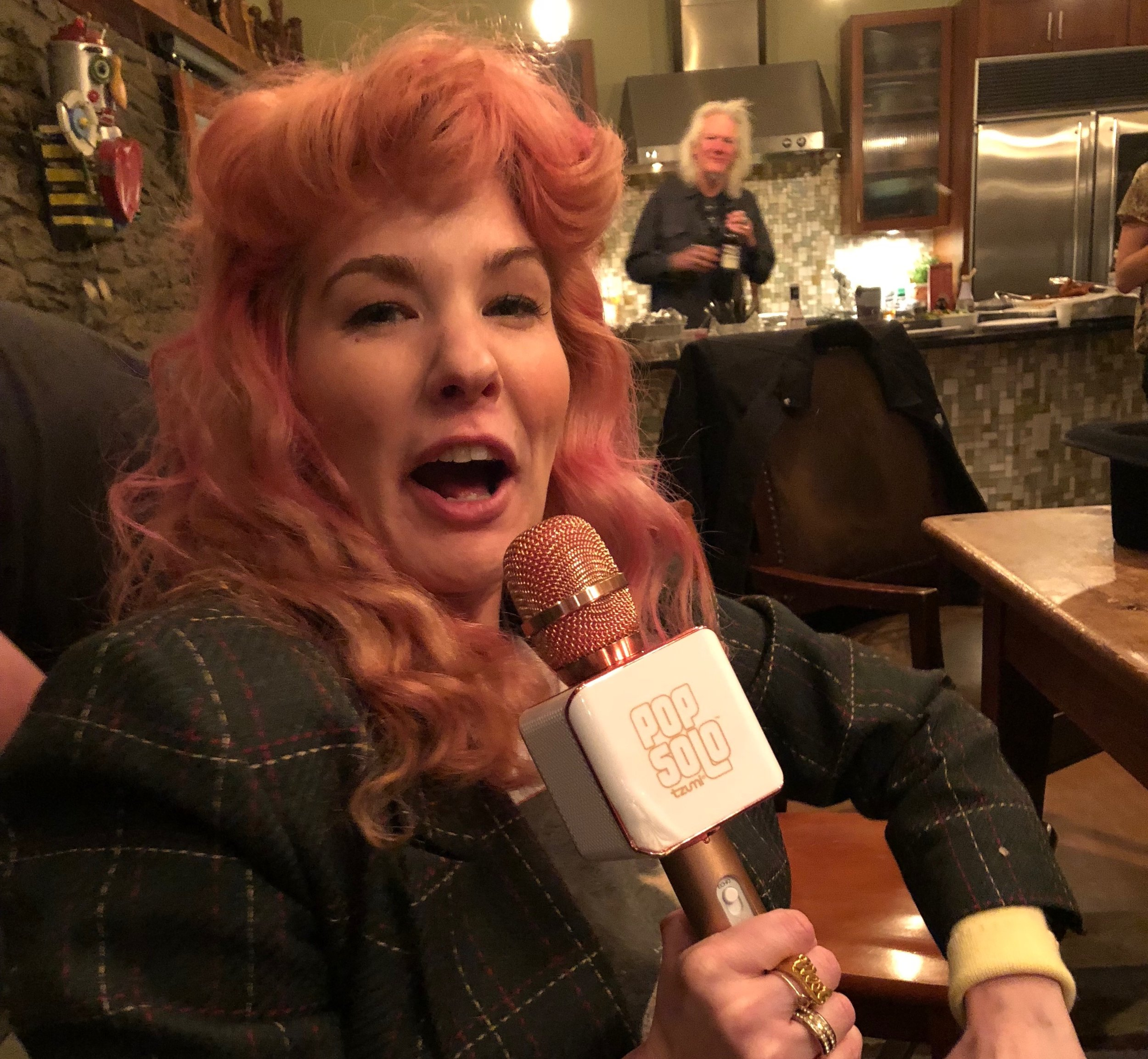 Check out her $19.99 Pop Solo mic! I need one of these too! (That's Skip in the back).