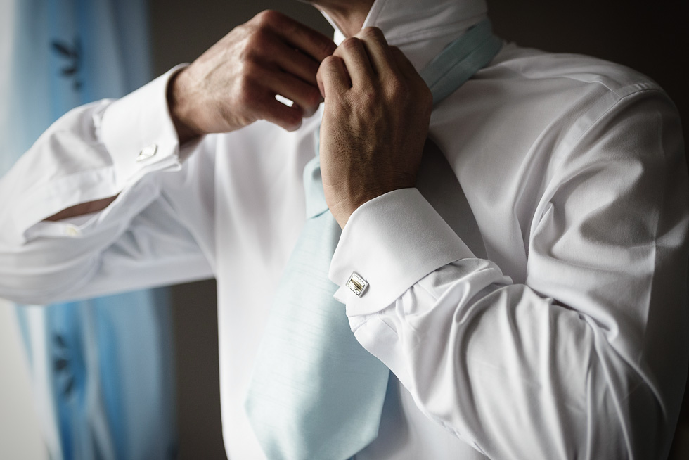 Groom buttoning shirt.jpg