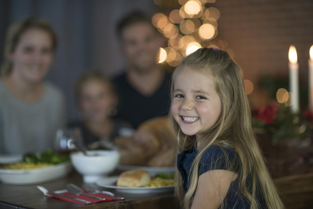 a-happy-child-eating-a-meal-with-her-family.jpg