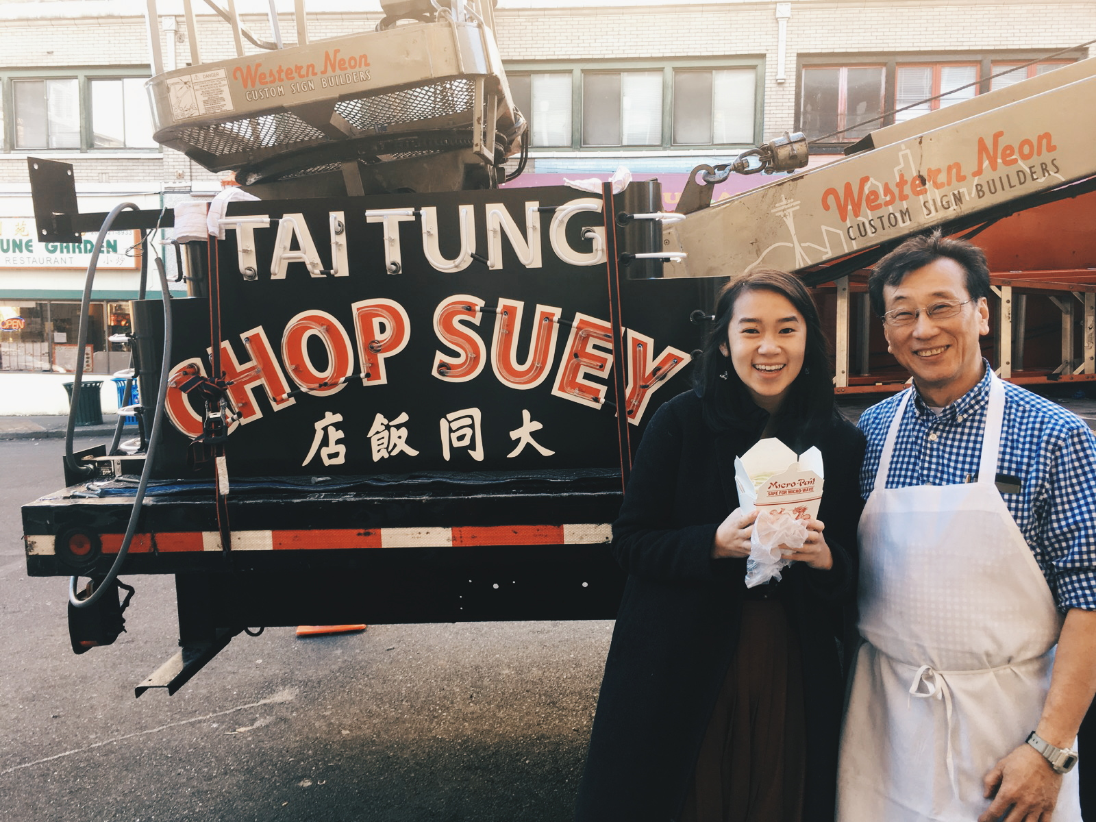 Me and Harry Chan, the owner of Tai Tung, standing next to the sign before it was installed. I am holding a to-go box filled with chop suey.