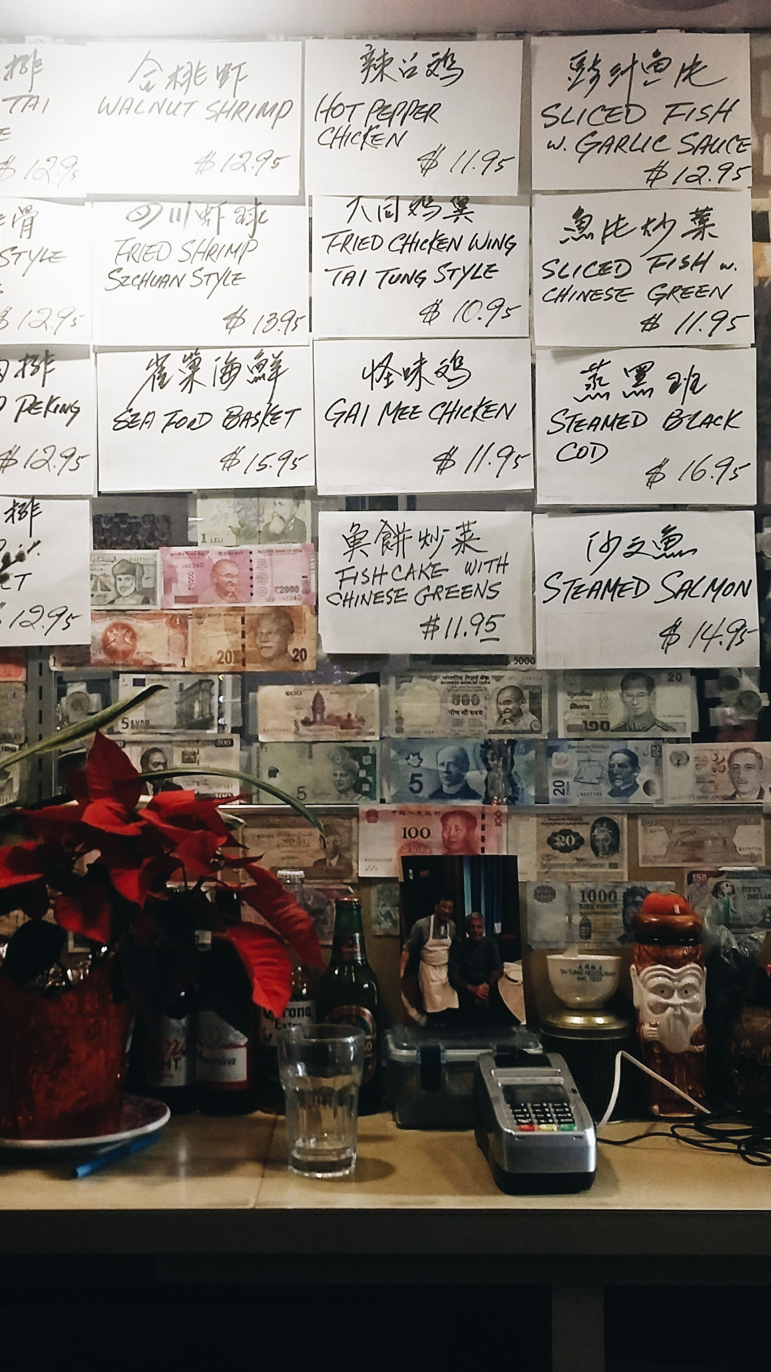 Tai Tung hasn't changed much since it opened in 1935. From the bar, you can see handwritten menu items taped to the mirror.