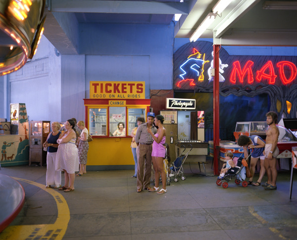 Casino, Asbury Park, New Jersey, 1980, by Joe Maloney. Digital archival pigment print of a ticket booth, games and rides in the casino interior.